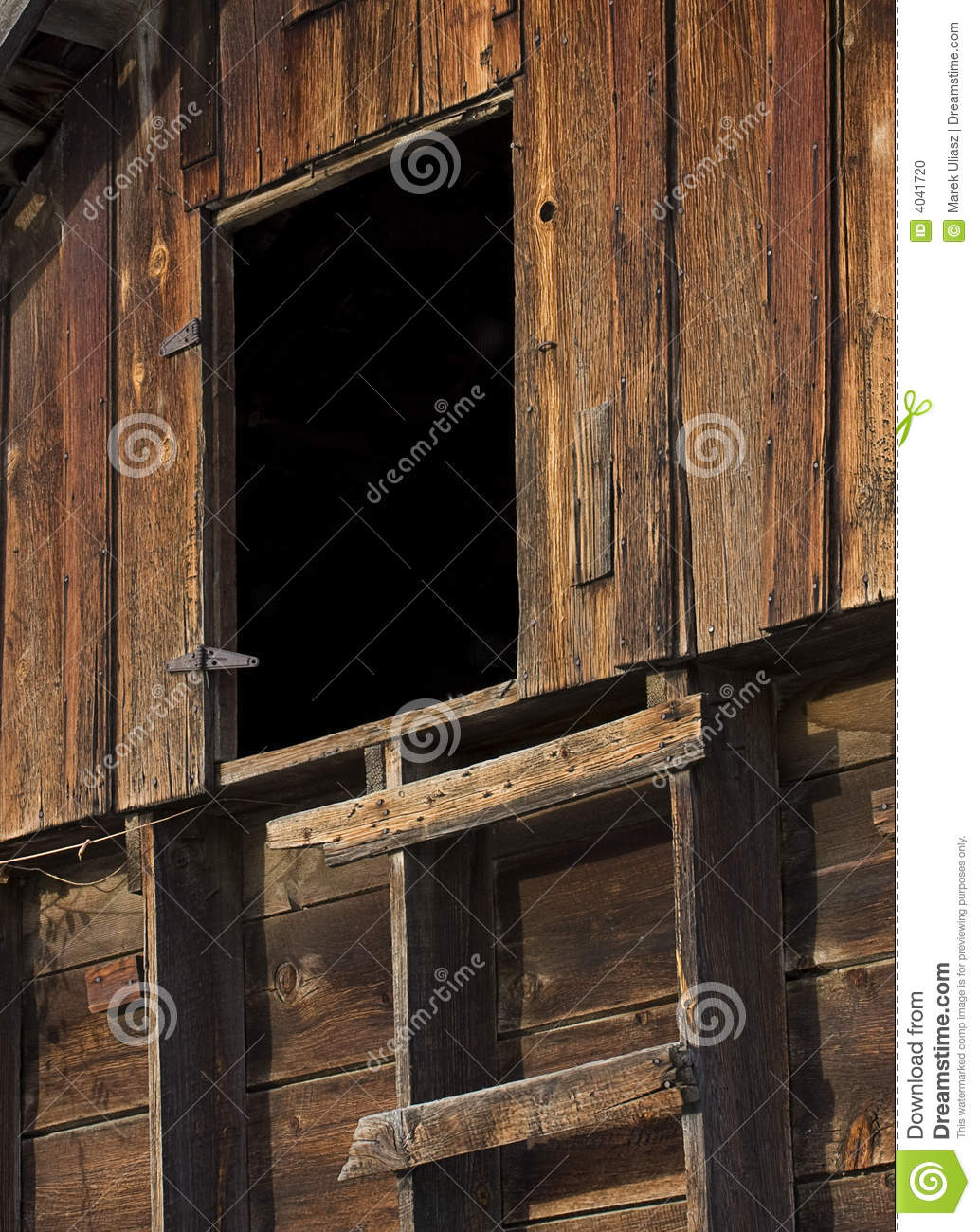 Primitive Ladder And Door In An Old Wooden Barn Stock