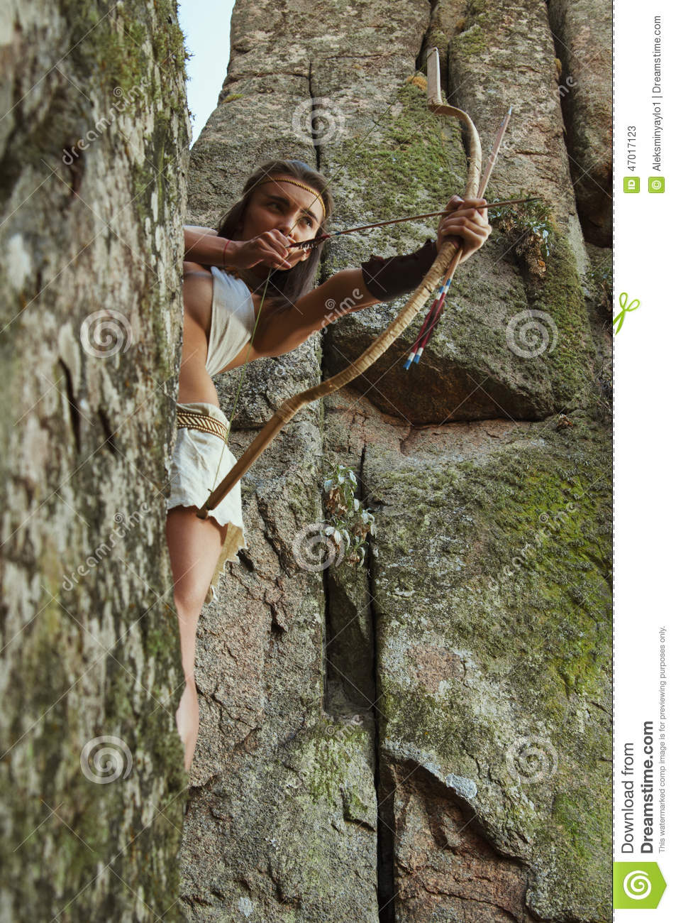 Primitive Woman Standing On A Rock And Holding A Bow. Amazon Woman ...