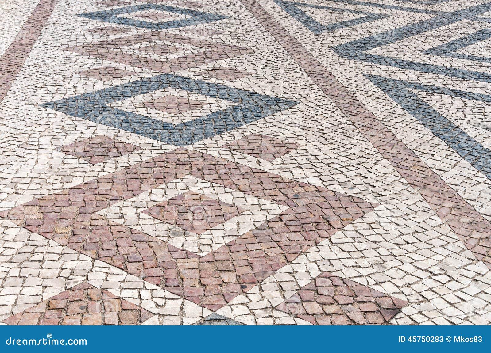 Primo piano di pavimentazione tipica portoghese, calcada