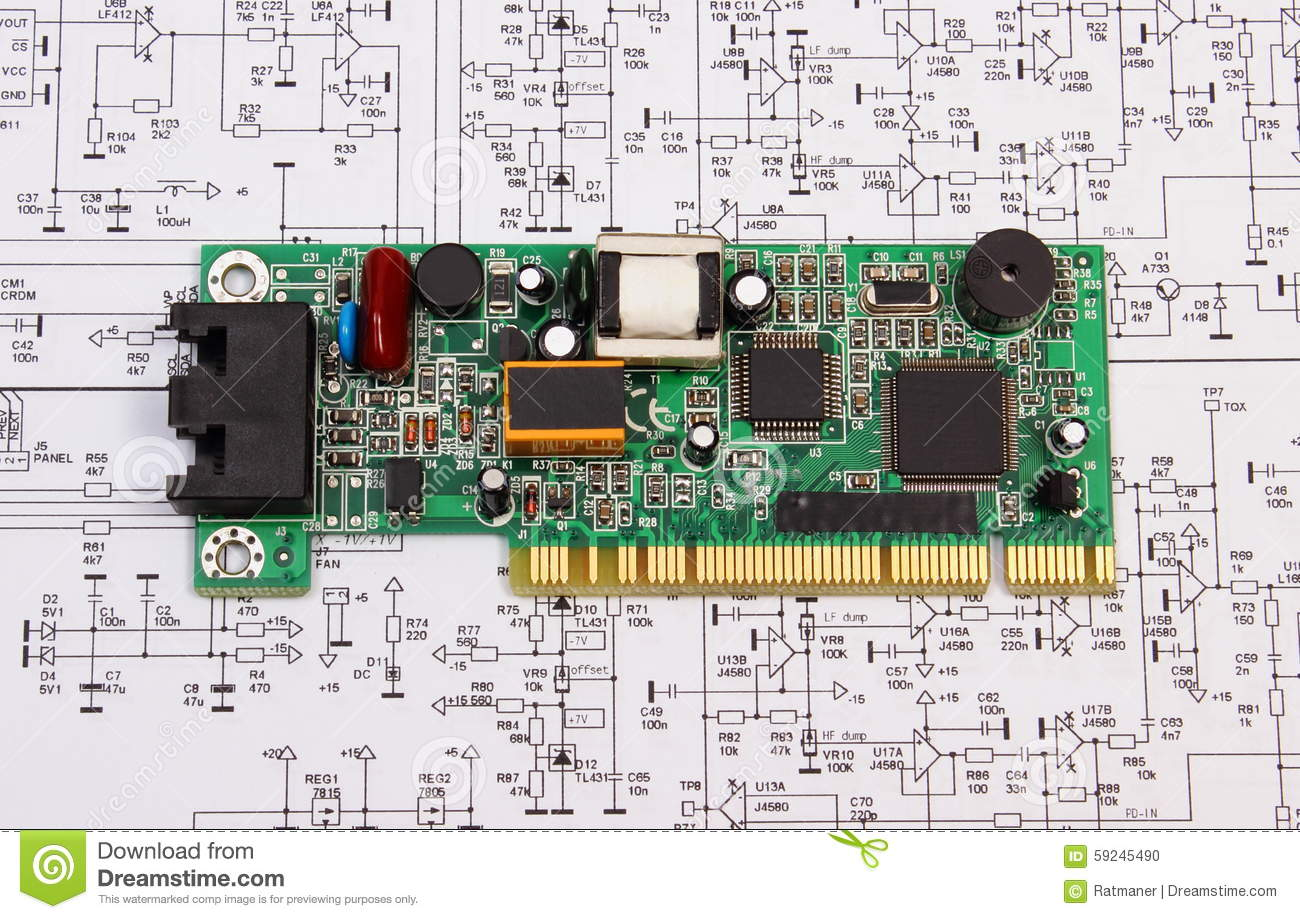Printed Circuit Board Lying On Diagram Of Electronics