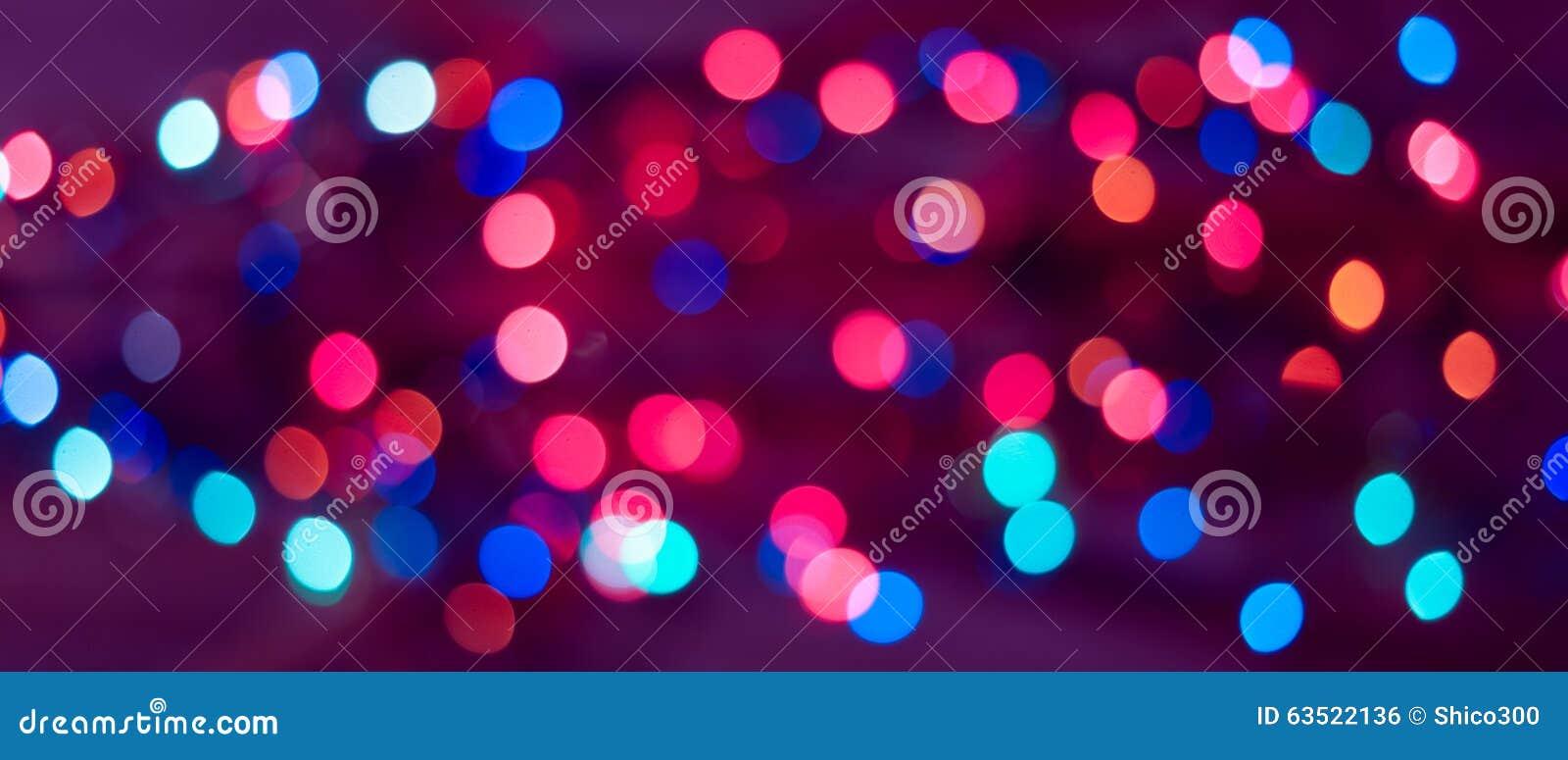 Priorità bassa di natale Fondo astratto festivo con le luci e le stelle defocused del bokeh