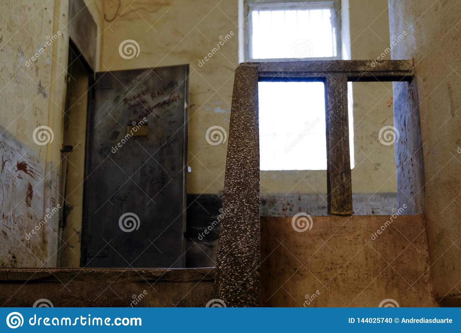 Prison stone stairs and metal door