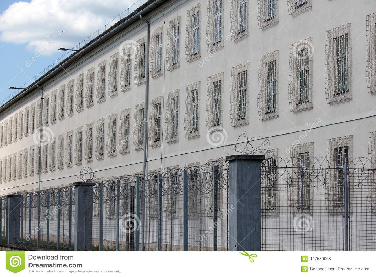Prison building with razor wire fence