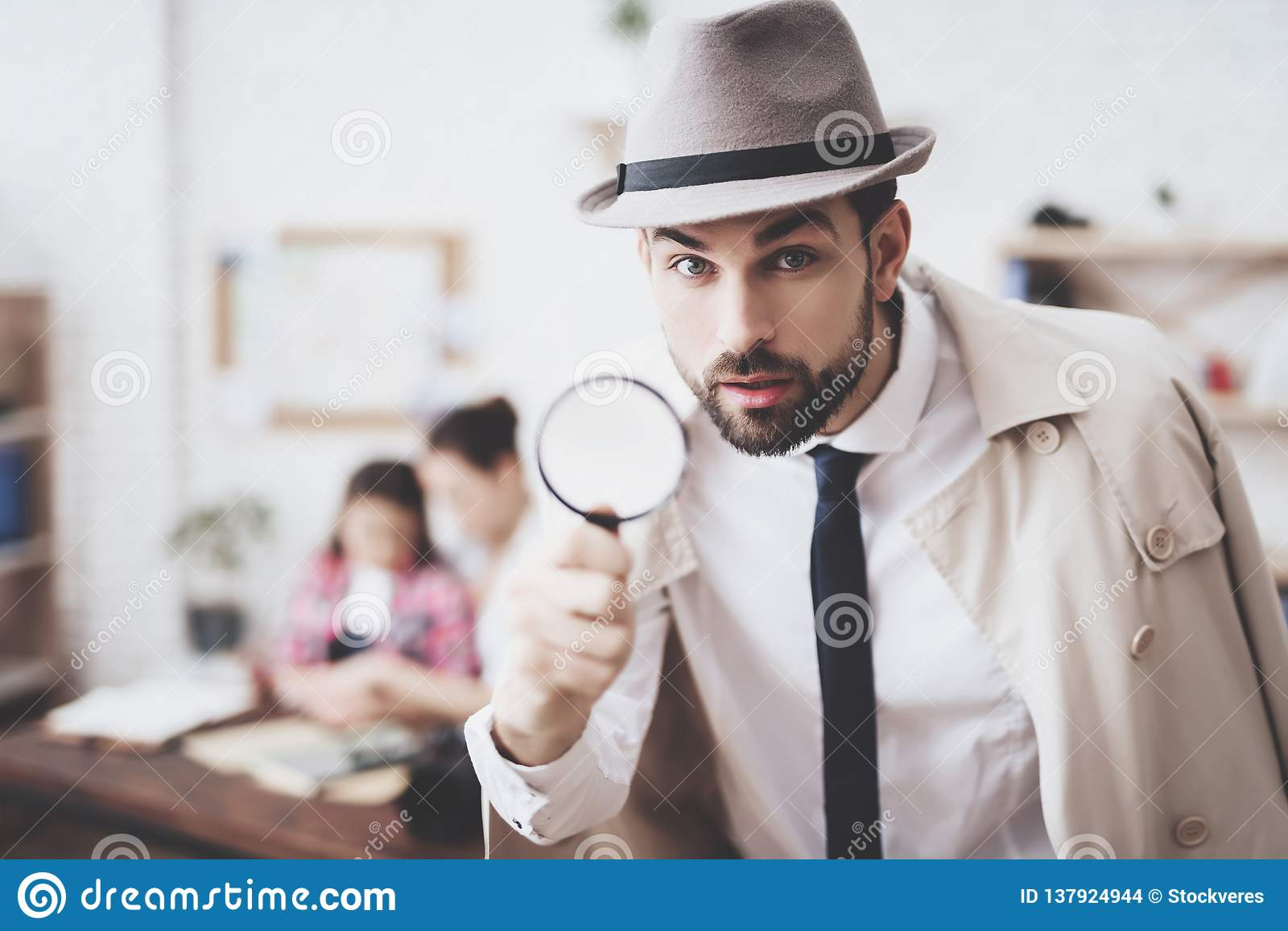 Private detective agency. Man is posing with magnifying glass, woman is holding her daughter.