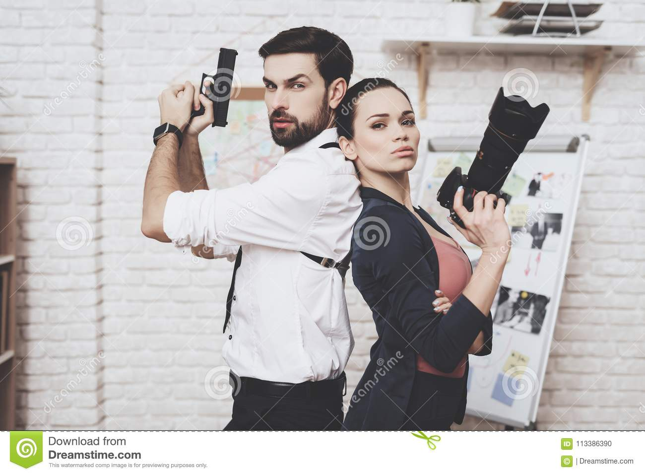Private Detective Agency  Woman Is Posing With Camera, Man Is Posing