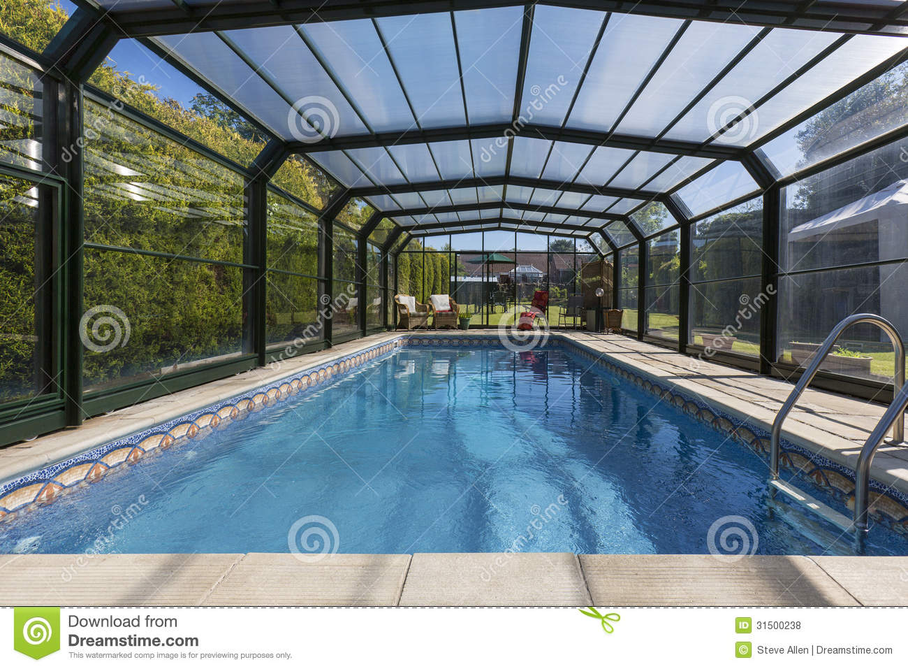 Private heated swimming pool enclosure royalty free for Big outdoor pool