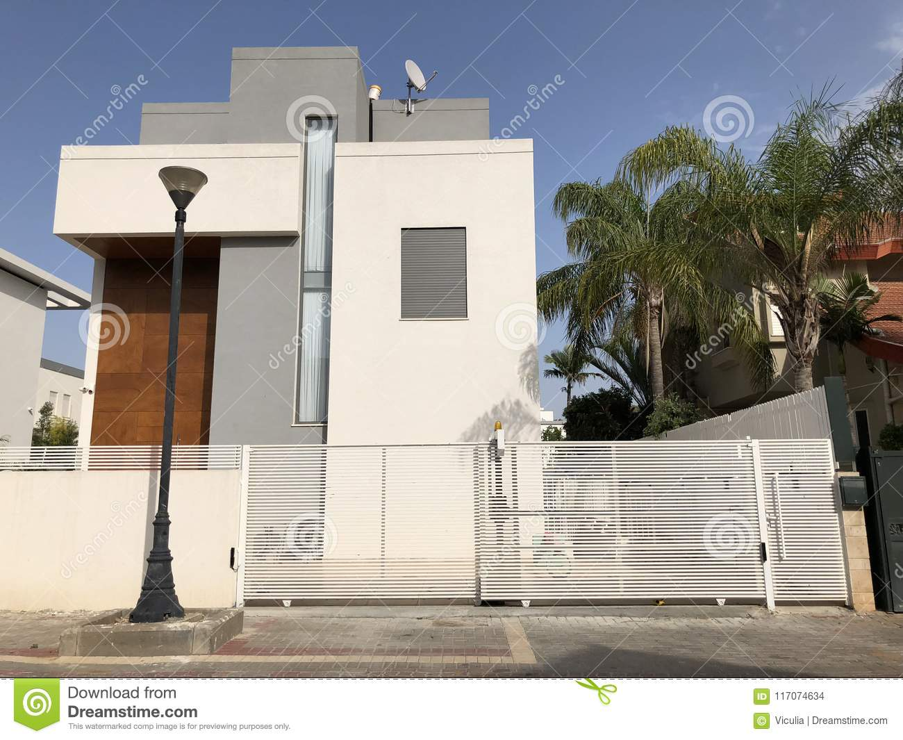 Private Modern Houses With Big White Fence On The Streets In Rishon ...