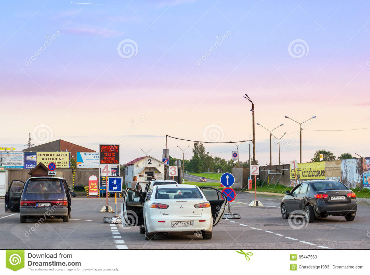 Private passenger cars parked in waiting area on Estonian-Russian state border