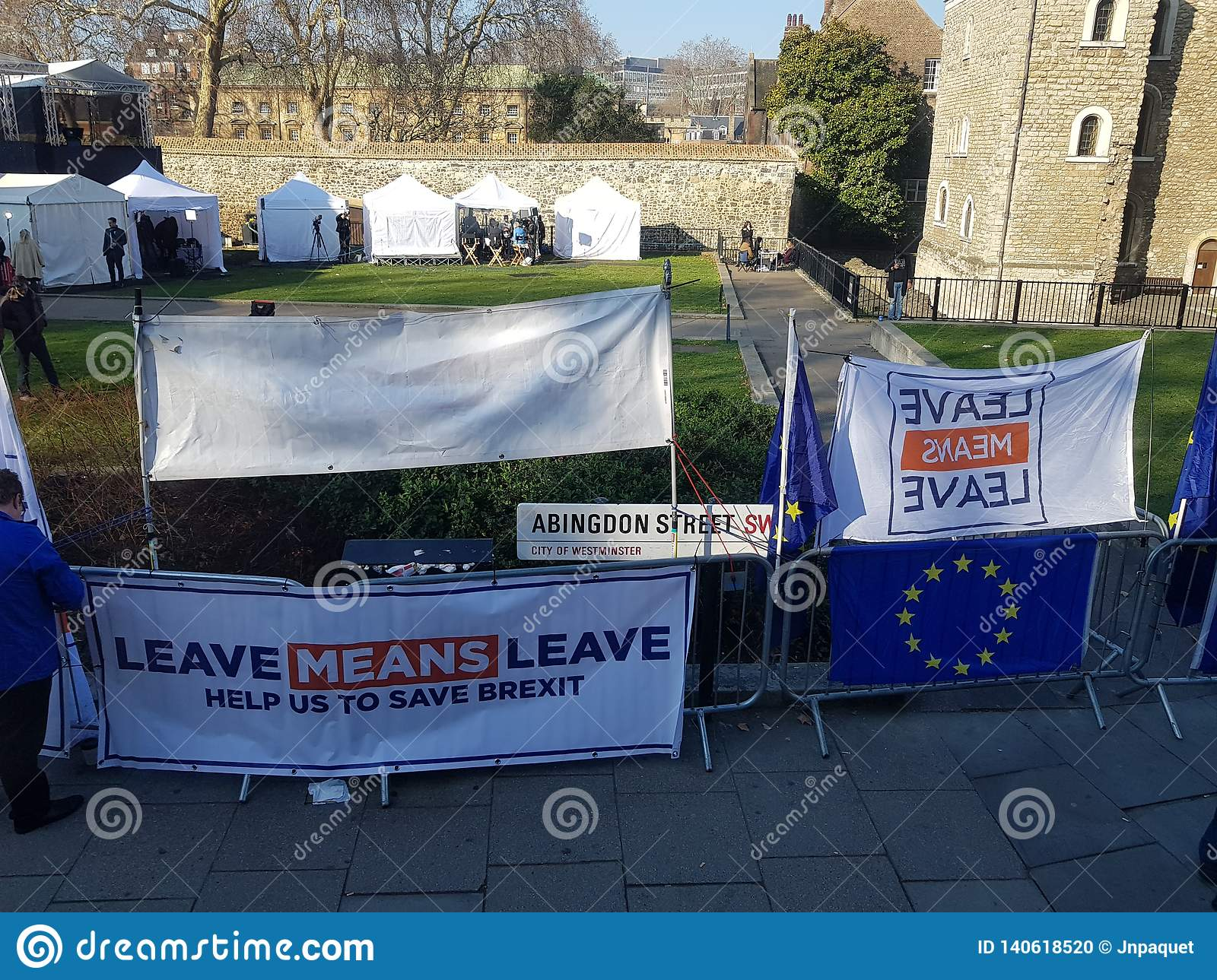 Pro-Brexit protest with pro-Brexit posters and flags.