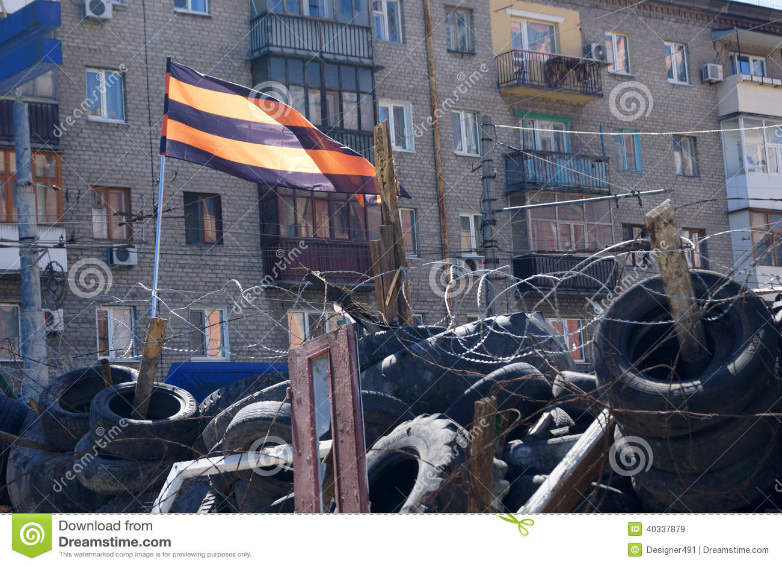 Pro-Russian separatist flag over the barricades. Lugansk, Ukraine