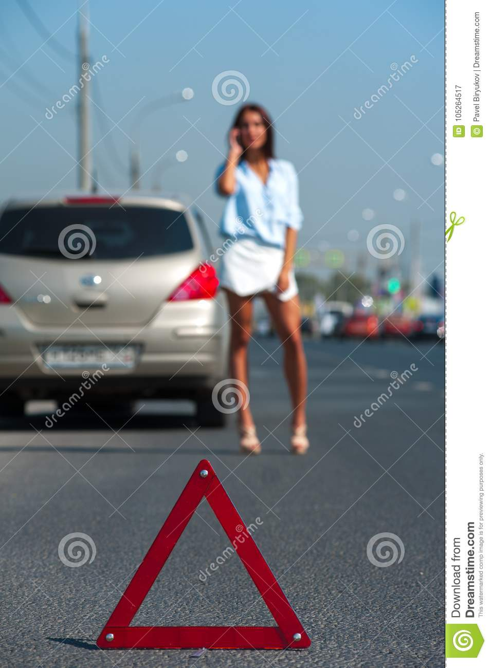 Young charming woman having problem with her car