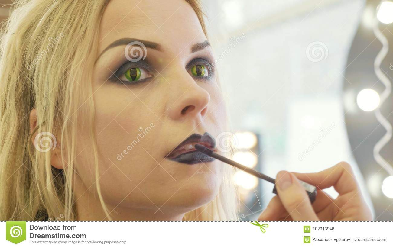 download process applying halloween makeup on face the young beautiful woman stock photo image of