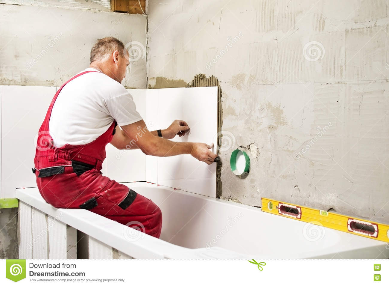The process of assembling white ceramic tile stock image image the process of assembling white ceramic tile dailygadgetfo Gallery