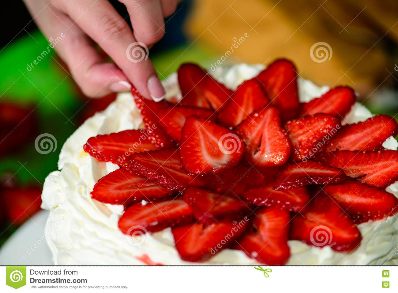Process Of Decorating Cake With Fresh Strawberries Stock Image