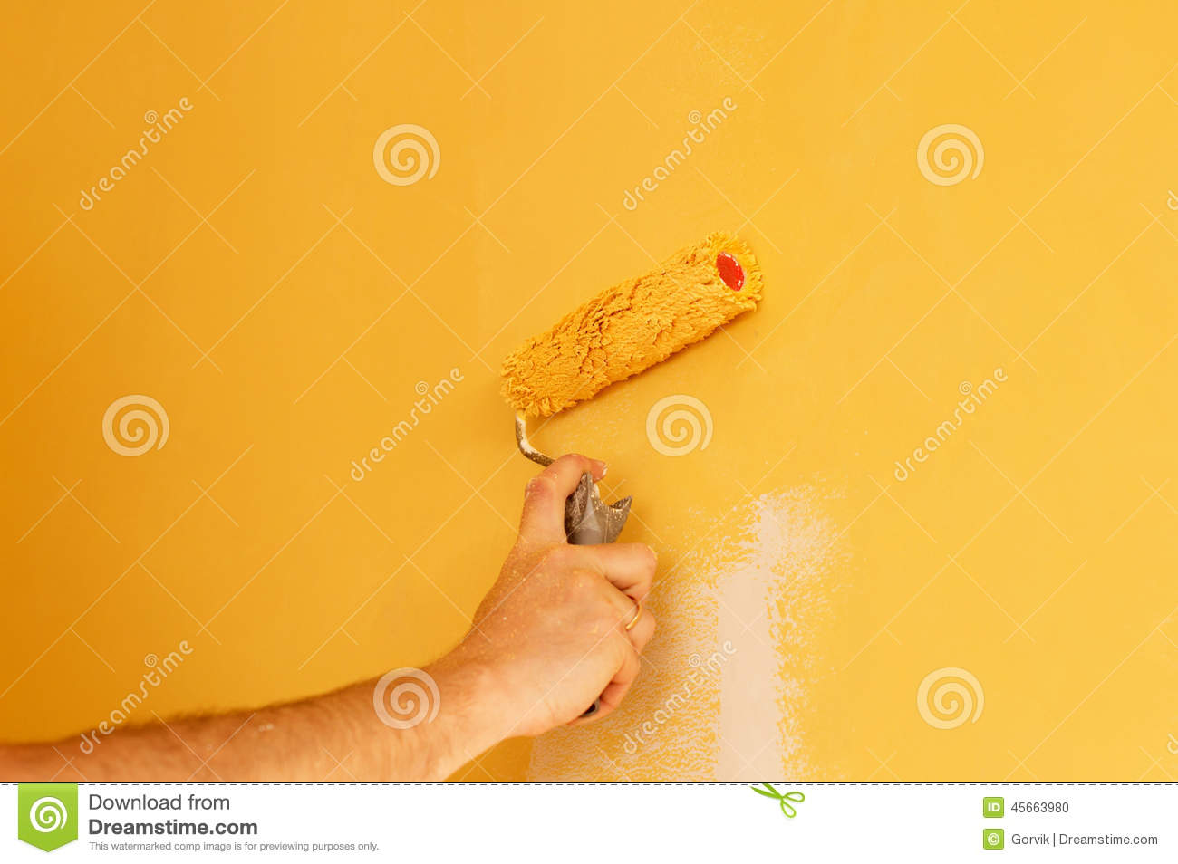 The Process Of Painting The Walls In Yellow Color Stock Photo ...