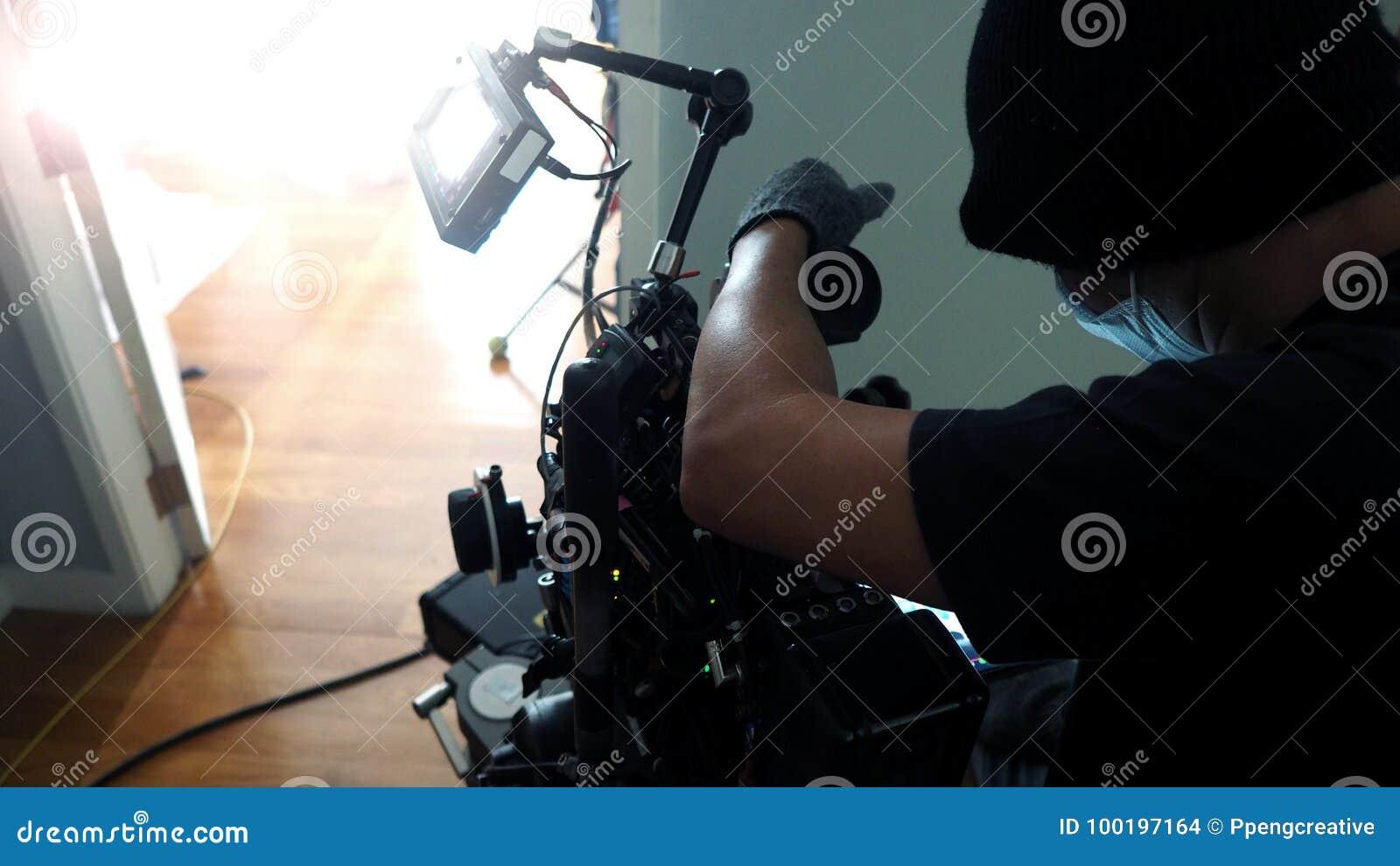 Producción video del tiroteo del fotógrafo con el sistema de la cámara