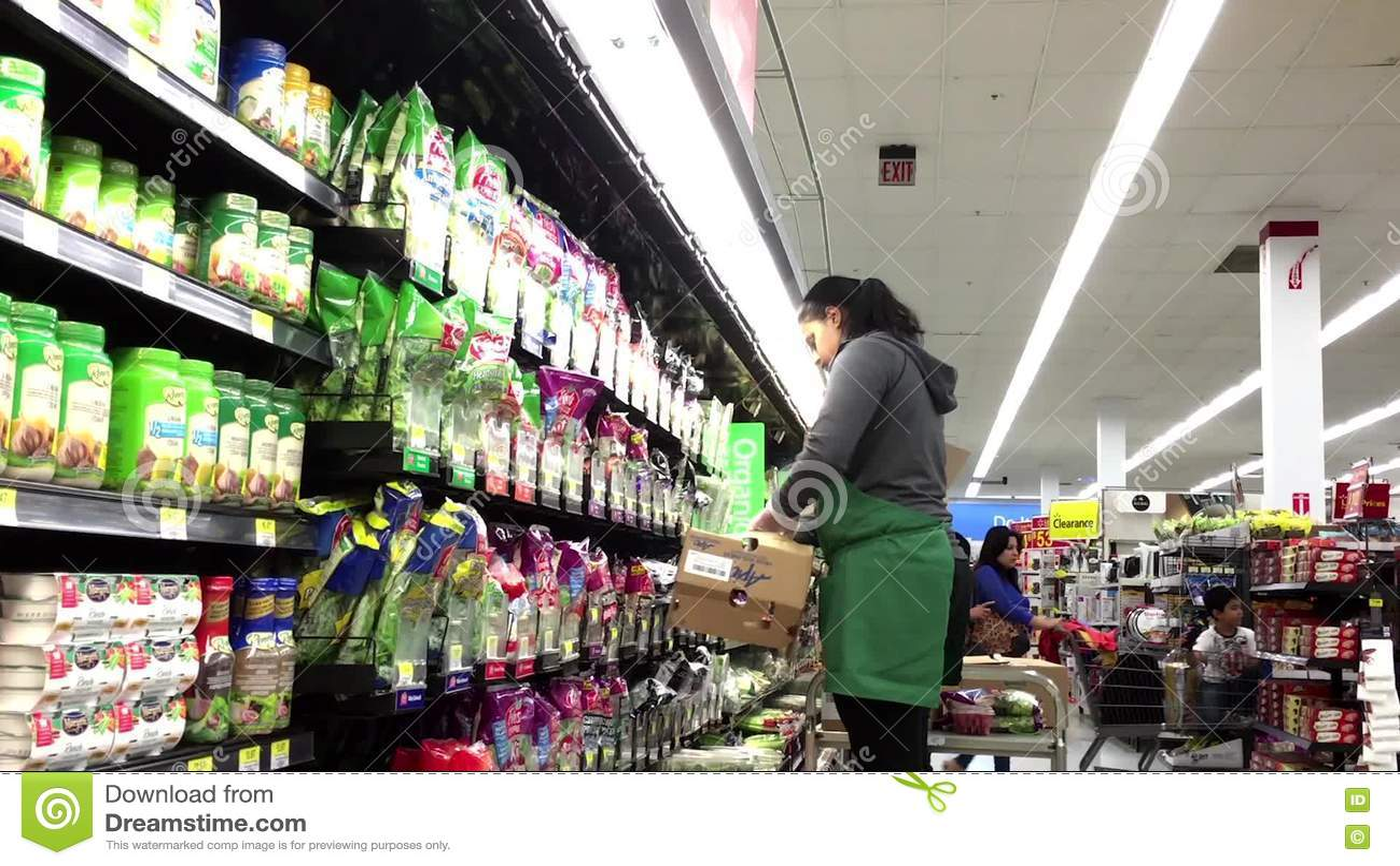 produce clerk stocking lettuce salad stock footage video