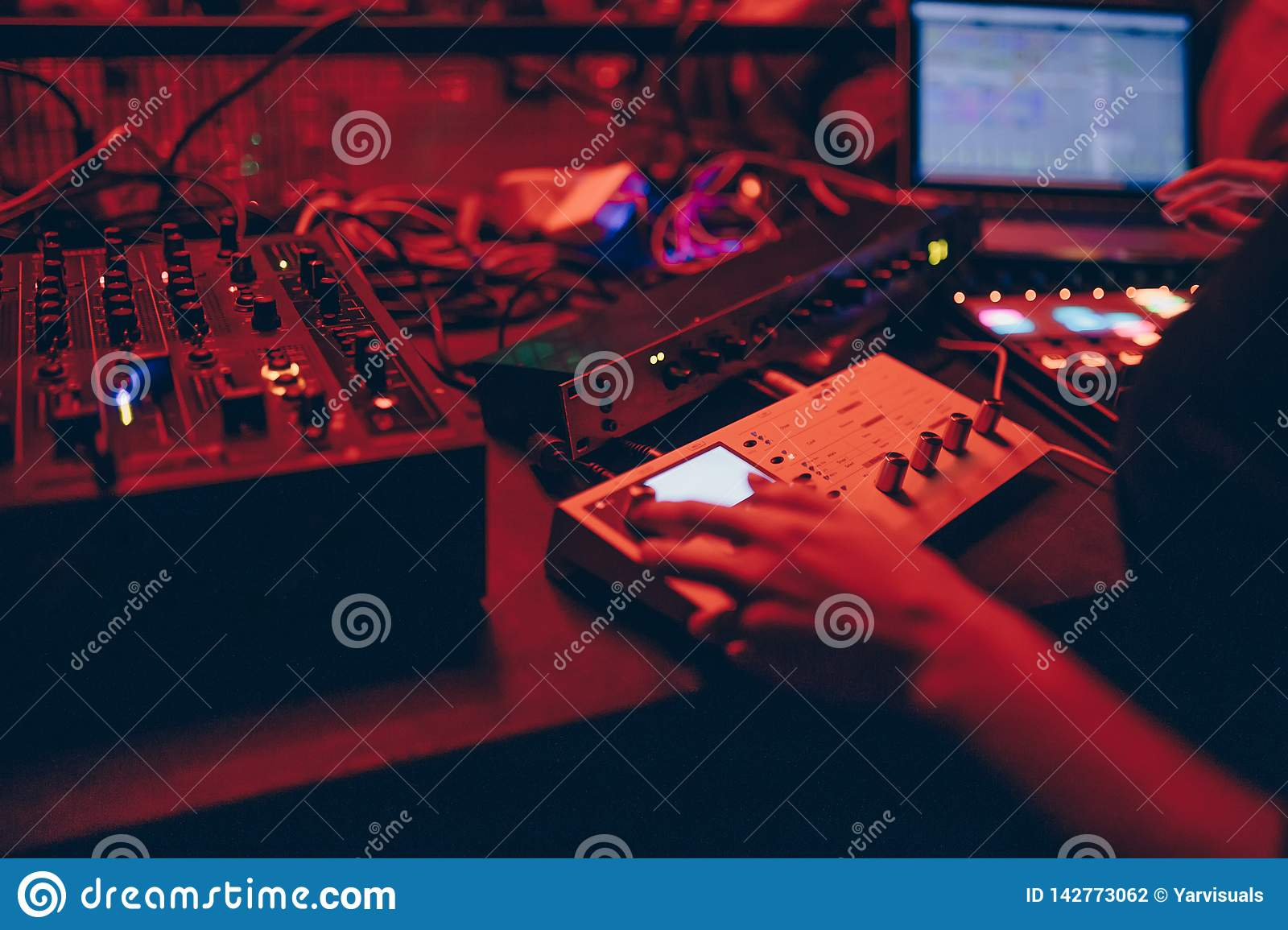 Producer DJ Mixer In A Nightclub With Glowing Plays Musical
