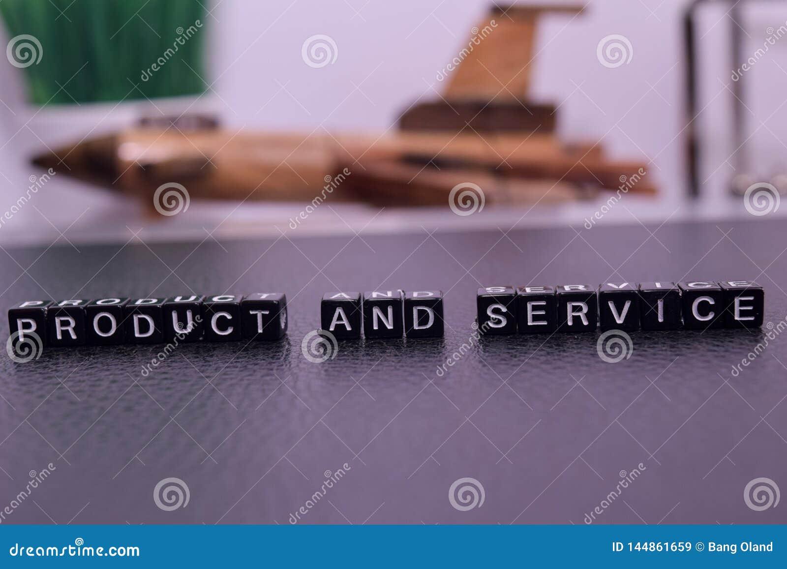 Product en de Dienst op houten blokken
