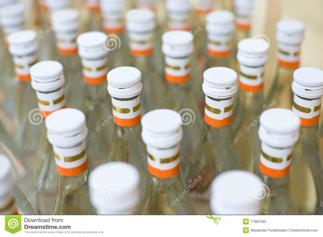 Many bottles of vodka at production line of distillery