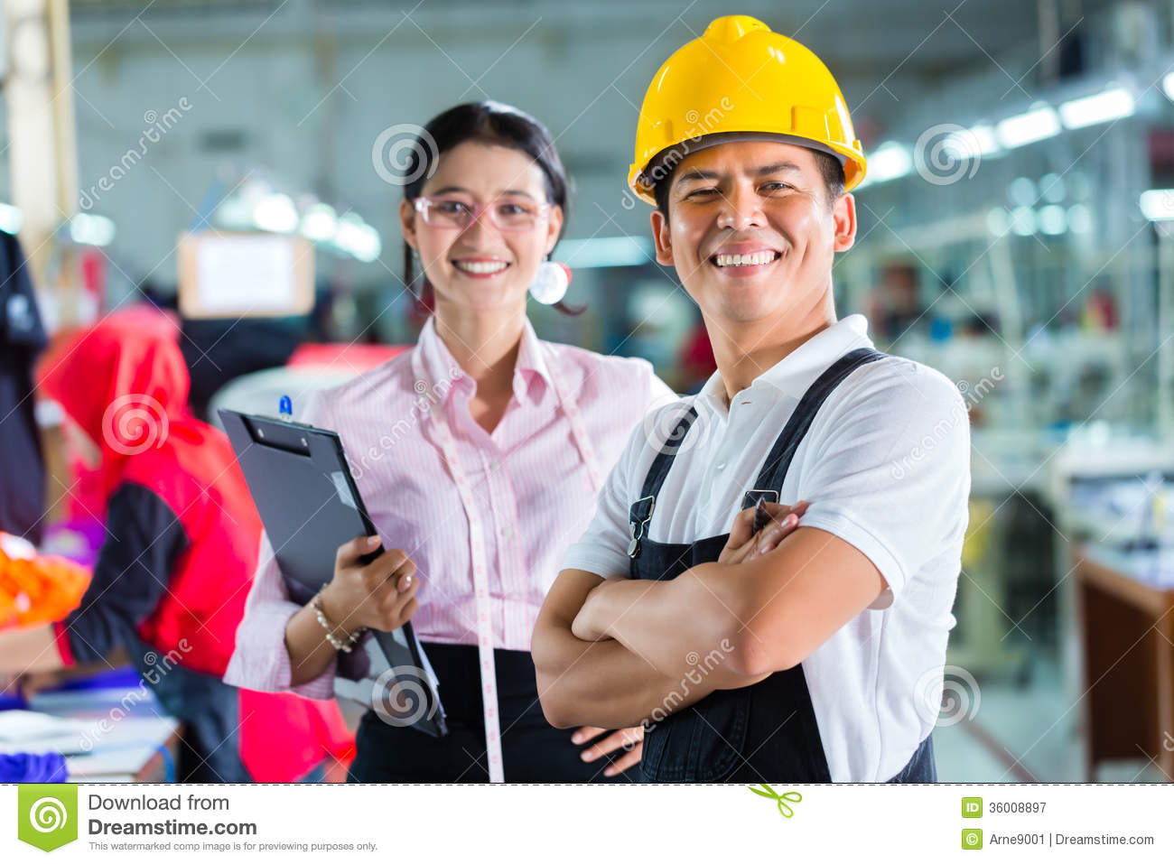 production manager and designer in asian factory royalty free stock photography - Fashion Production Manager