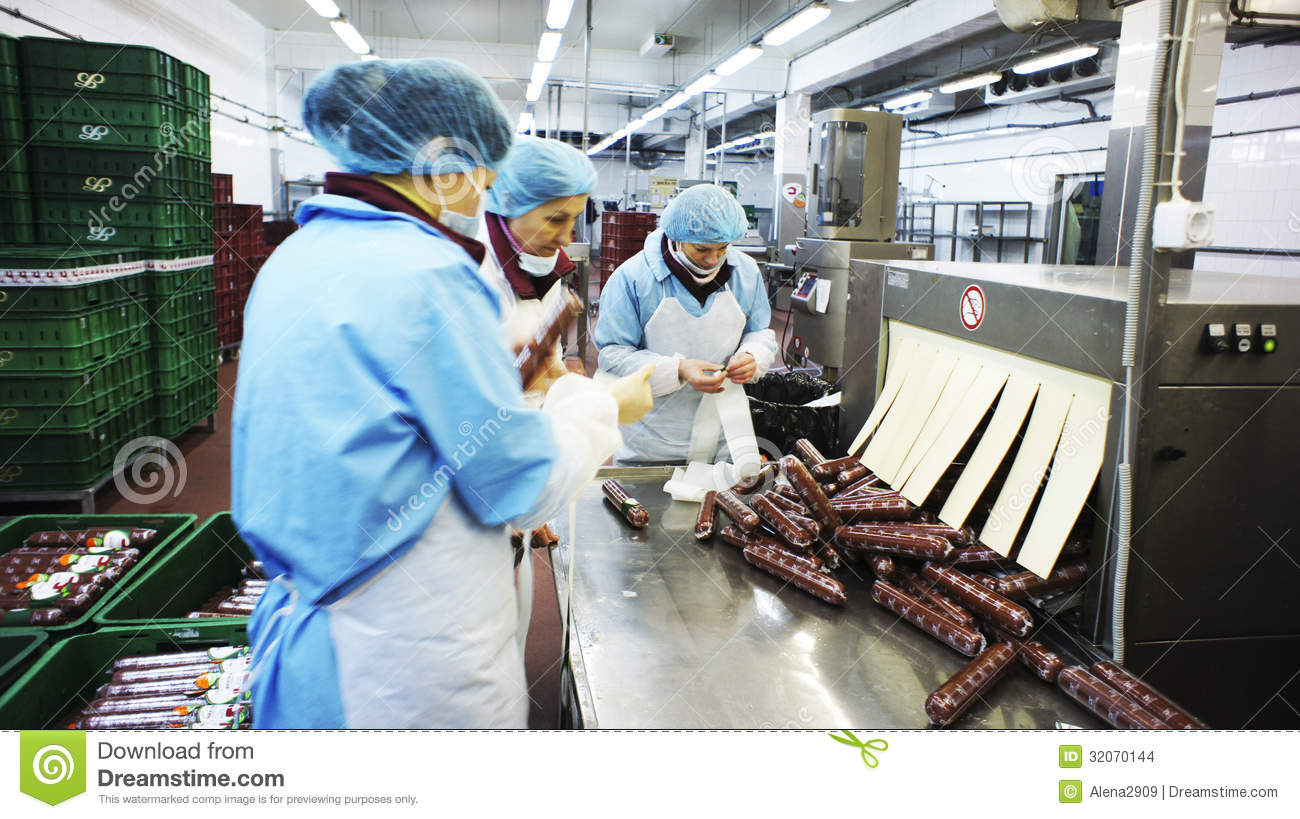 Packing Plant Produce : Production of sausages sausage factory editorial stock