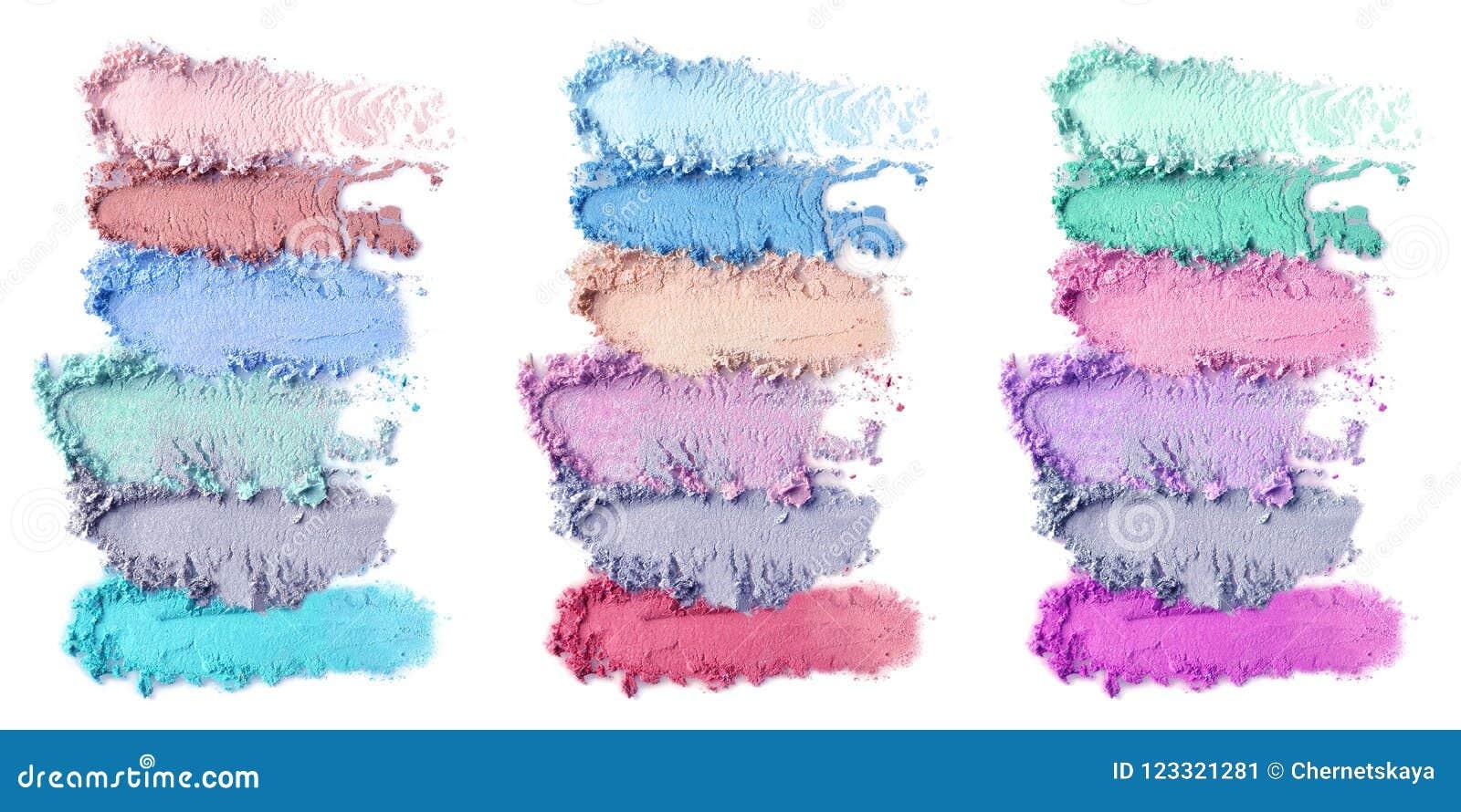 Produits de maquillage écrasés sur le fond blanc Ensemble de couleur de fards à paupières