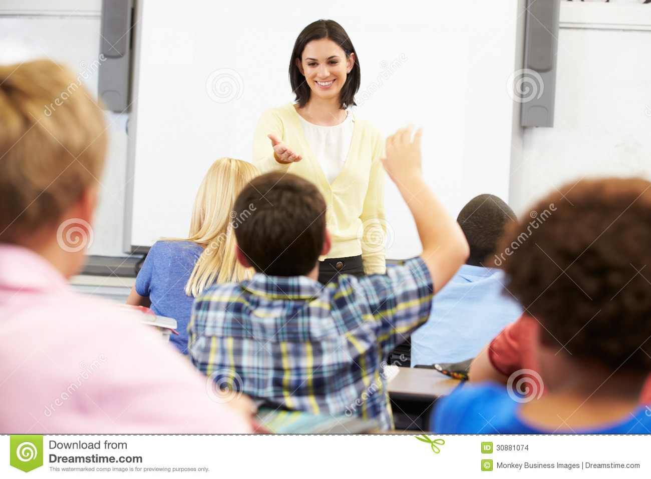 Profesor Standing In Front Of Class Asking Question