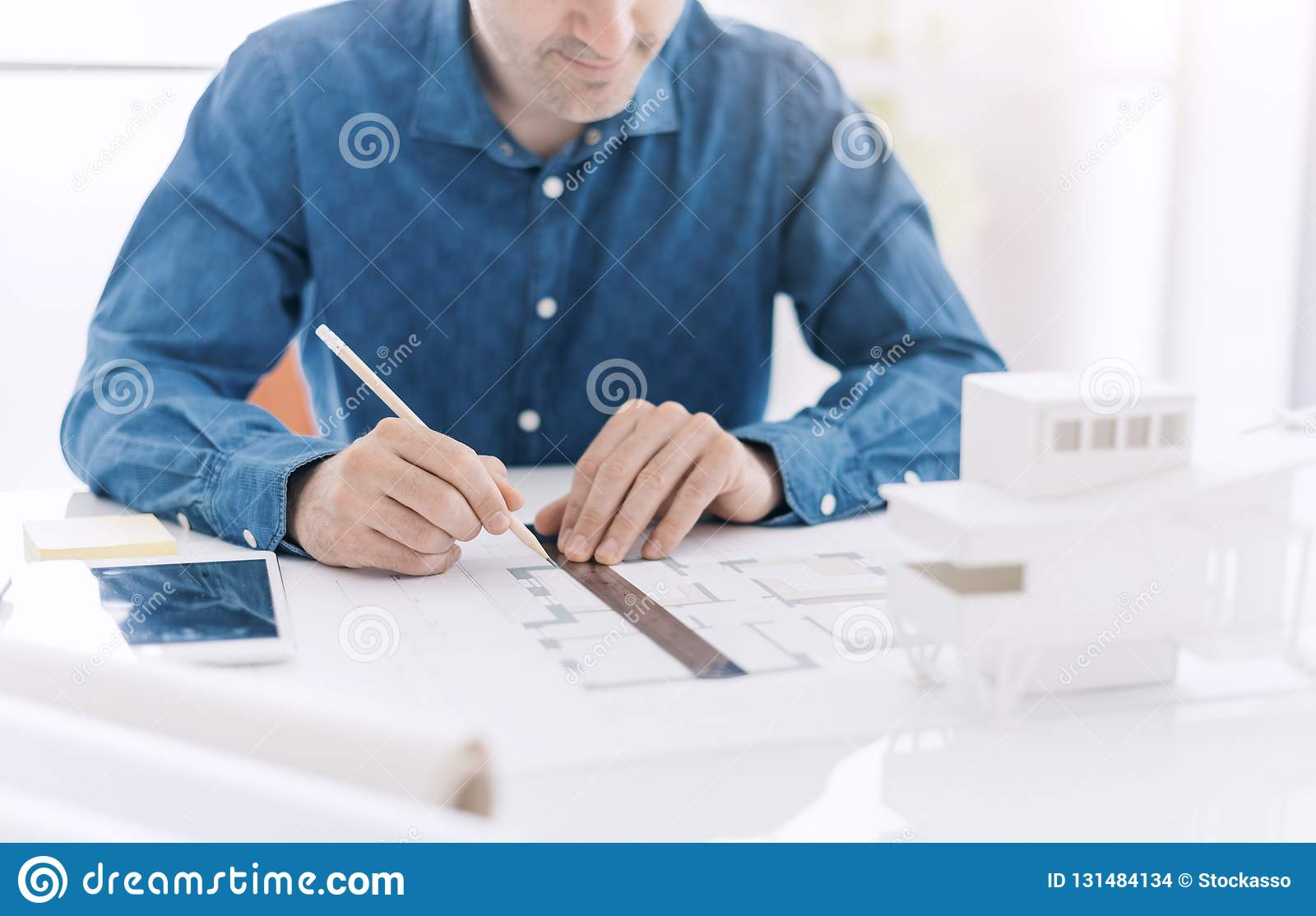 Professional Architect Working At Office Desk, He Is Drawing