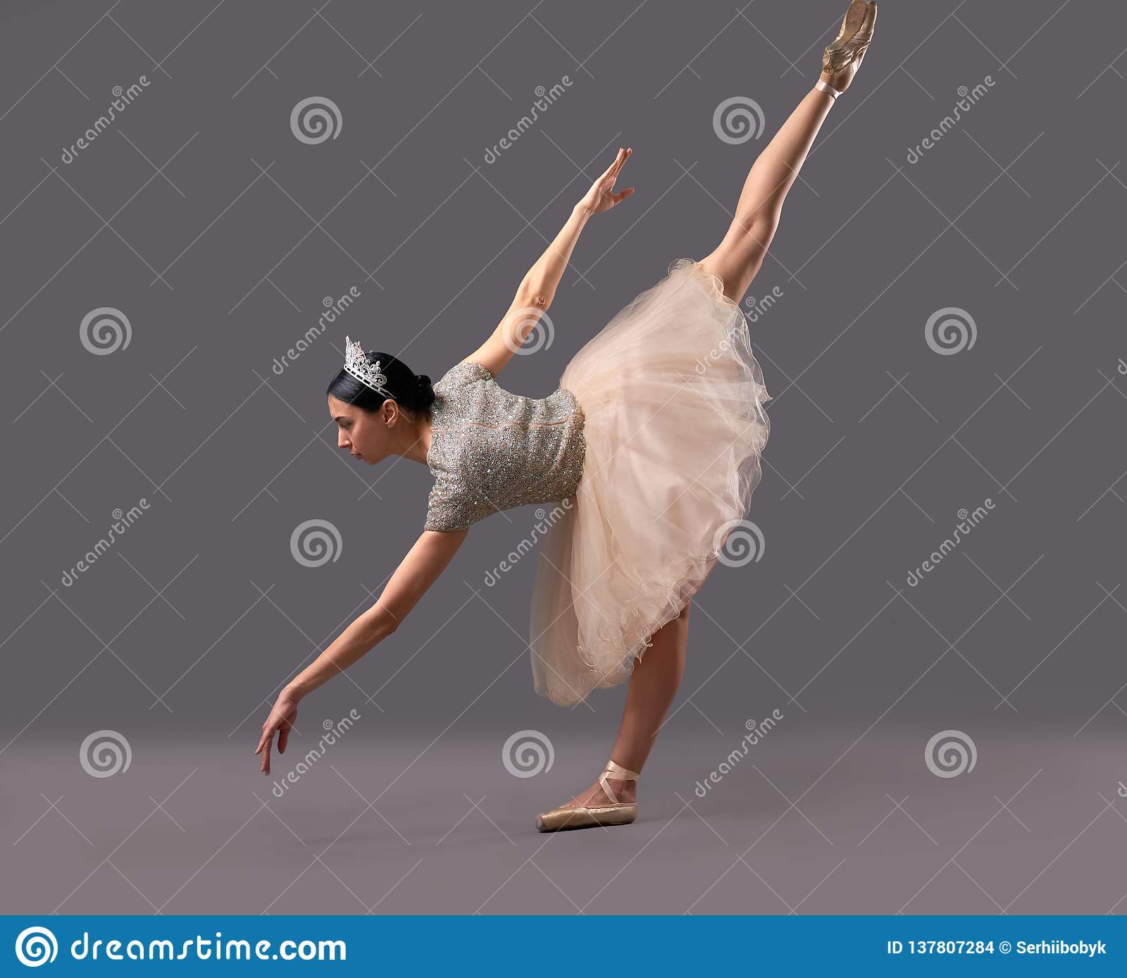 best service 9fb6e 84f6a Ballerina Bending Down And Raising One Leg Up In Studio ...