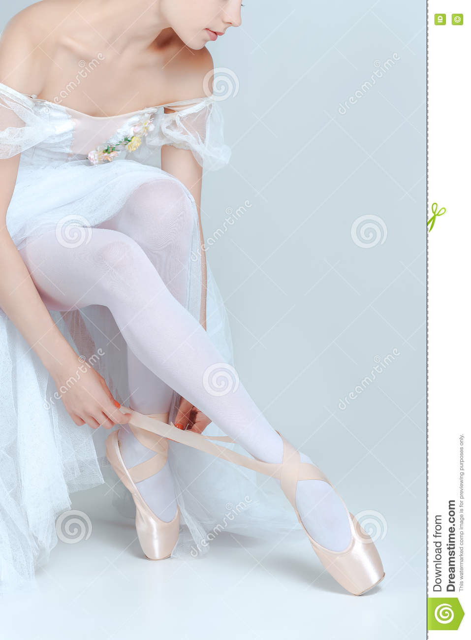 Professional Ballerina Putting On Her Ballet Shoes Stock