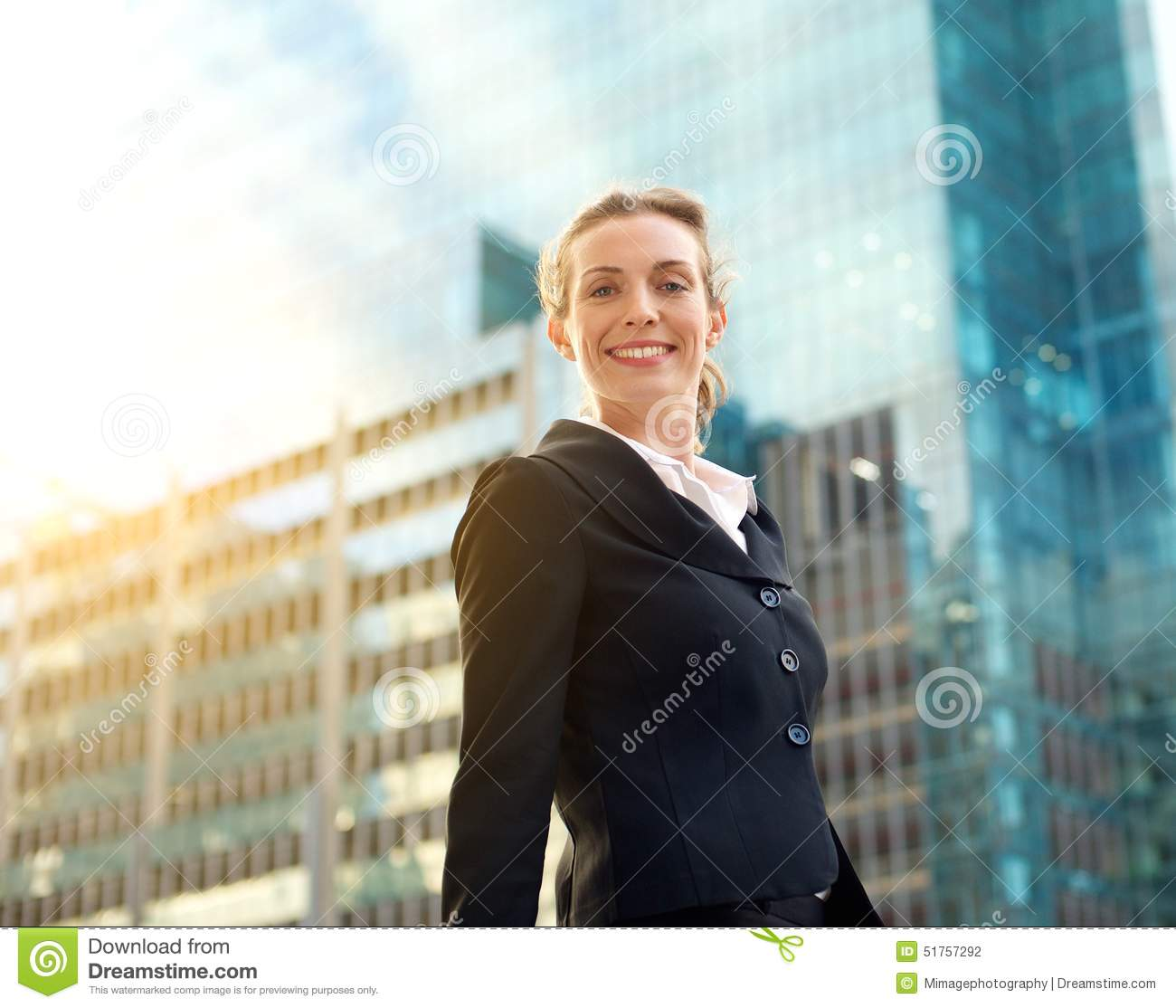 Professional Business Woman Smiling Outside In The City #0: professional business woman smiling outside city portrait buildings background