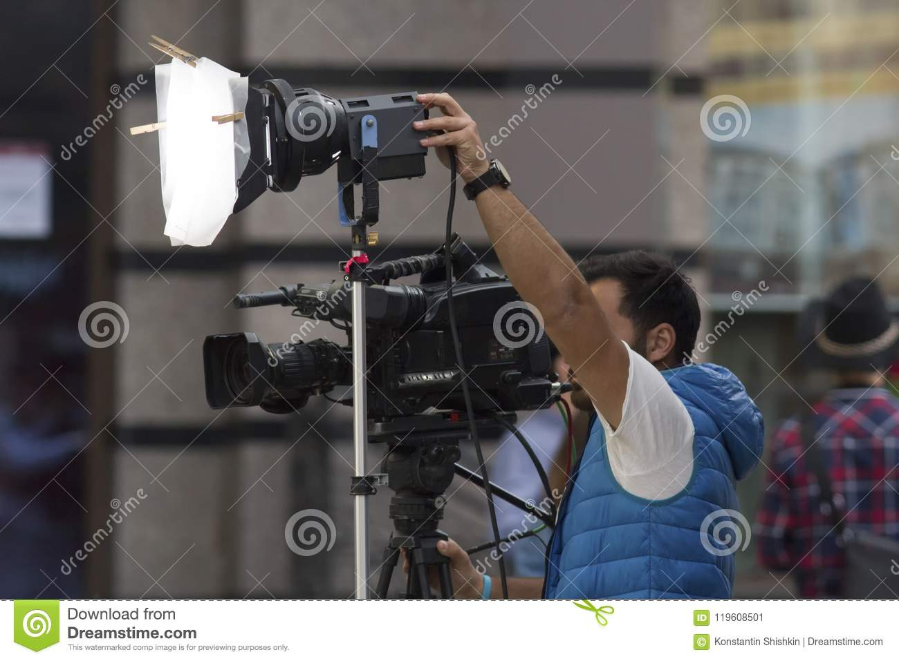 Professional cameraman shooting a video on the street