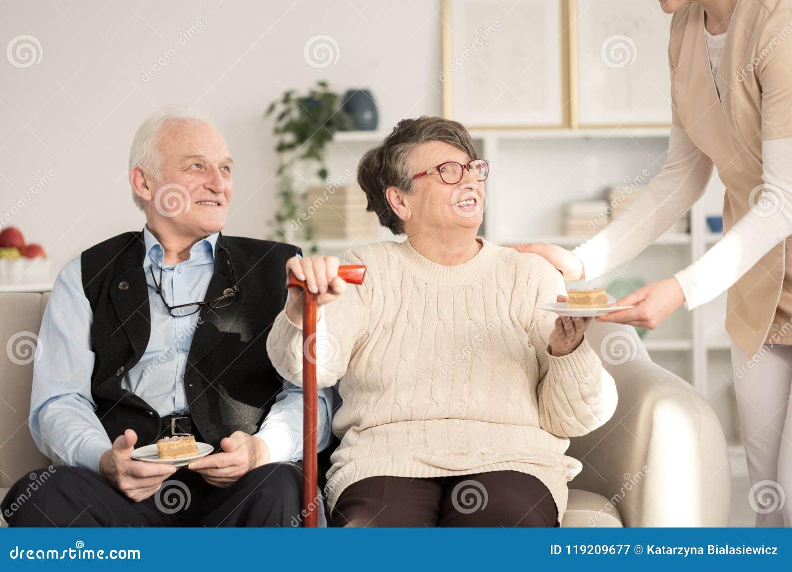 Caregiver serving cake