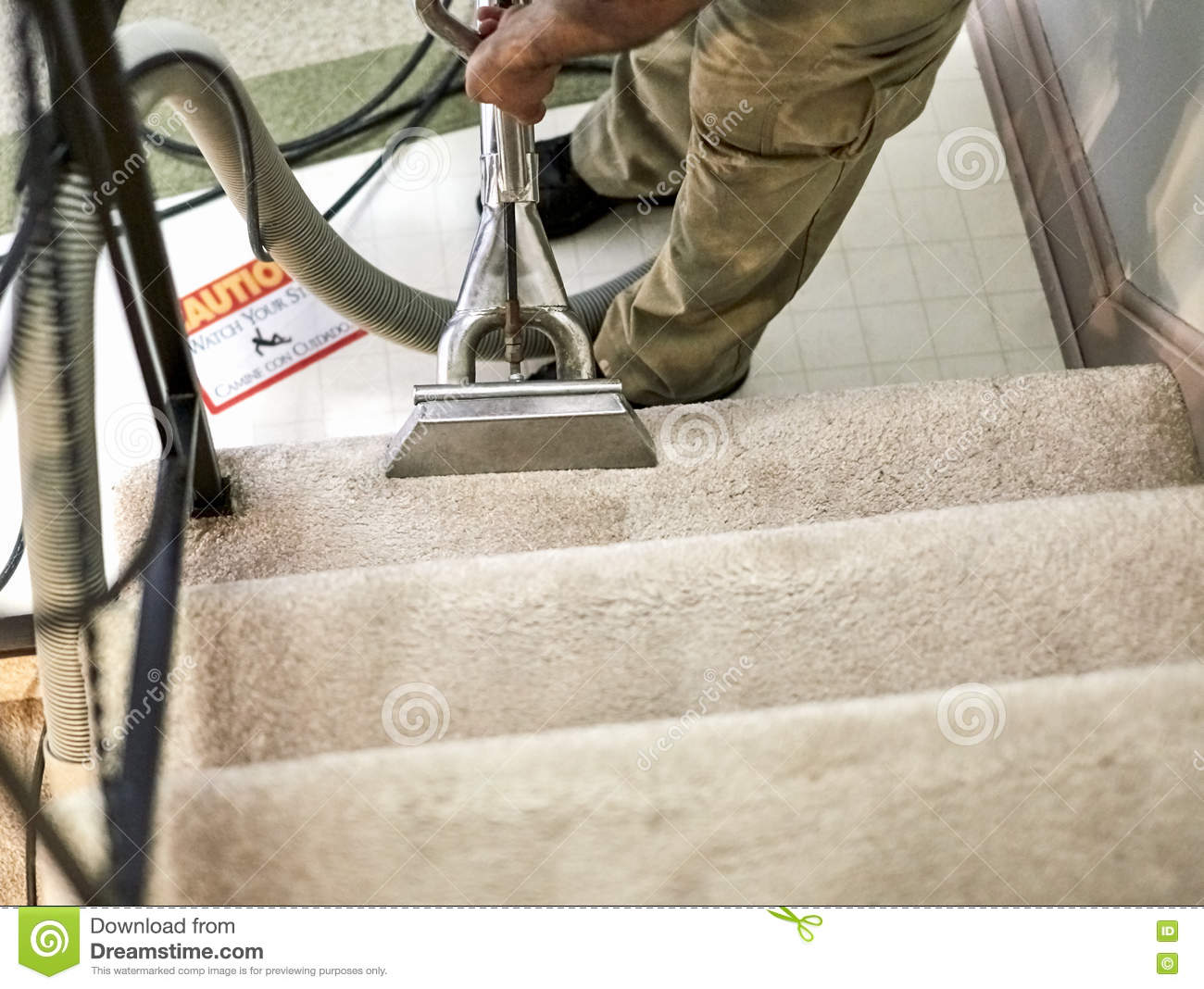 Professional carpet cleaner workin on the stairs stock for House cleaning stock photos