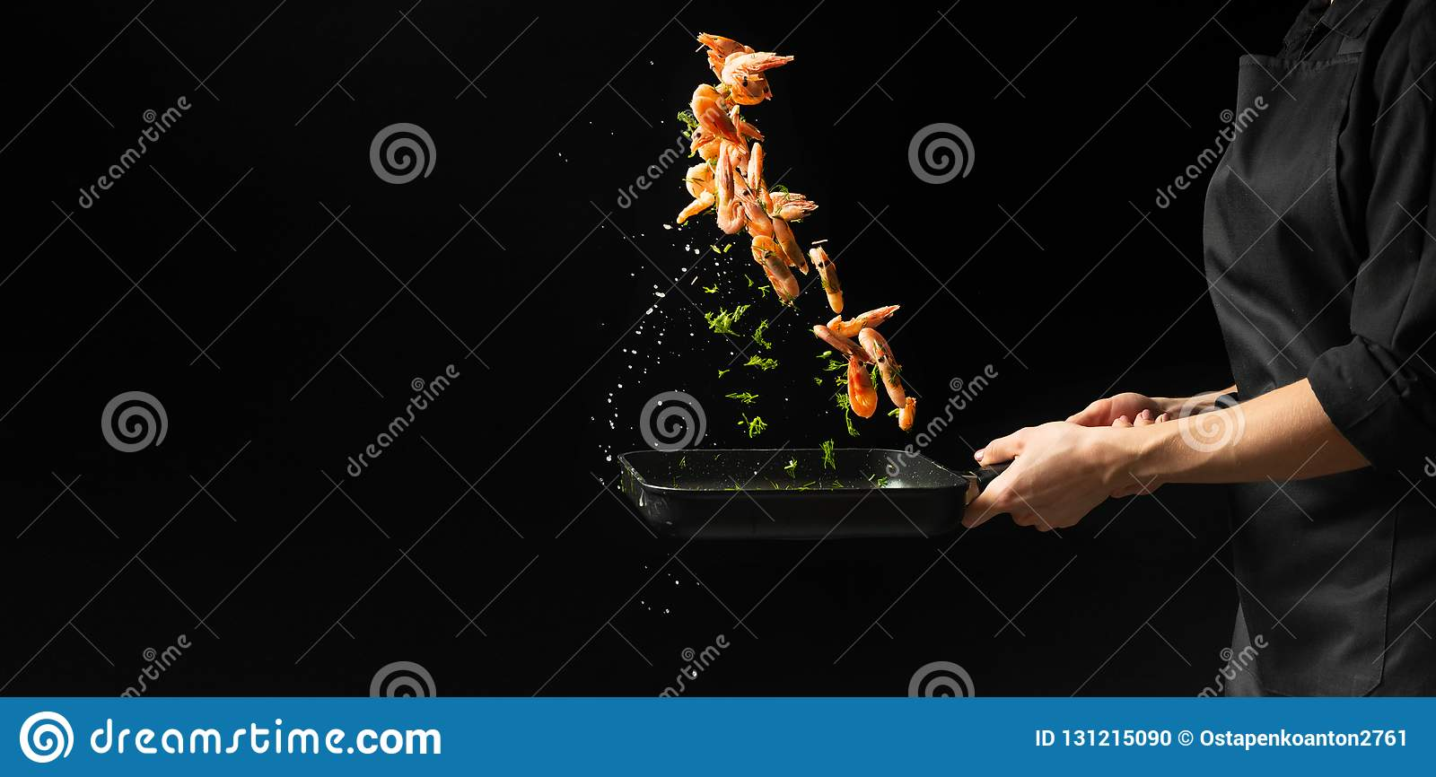 Professional chef prepares shrimps with greens. Cooking seafood, healthy vegetarian food, and food on a dark background. Horizonta