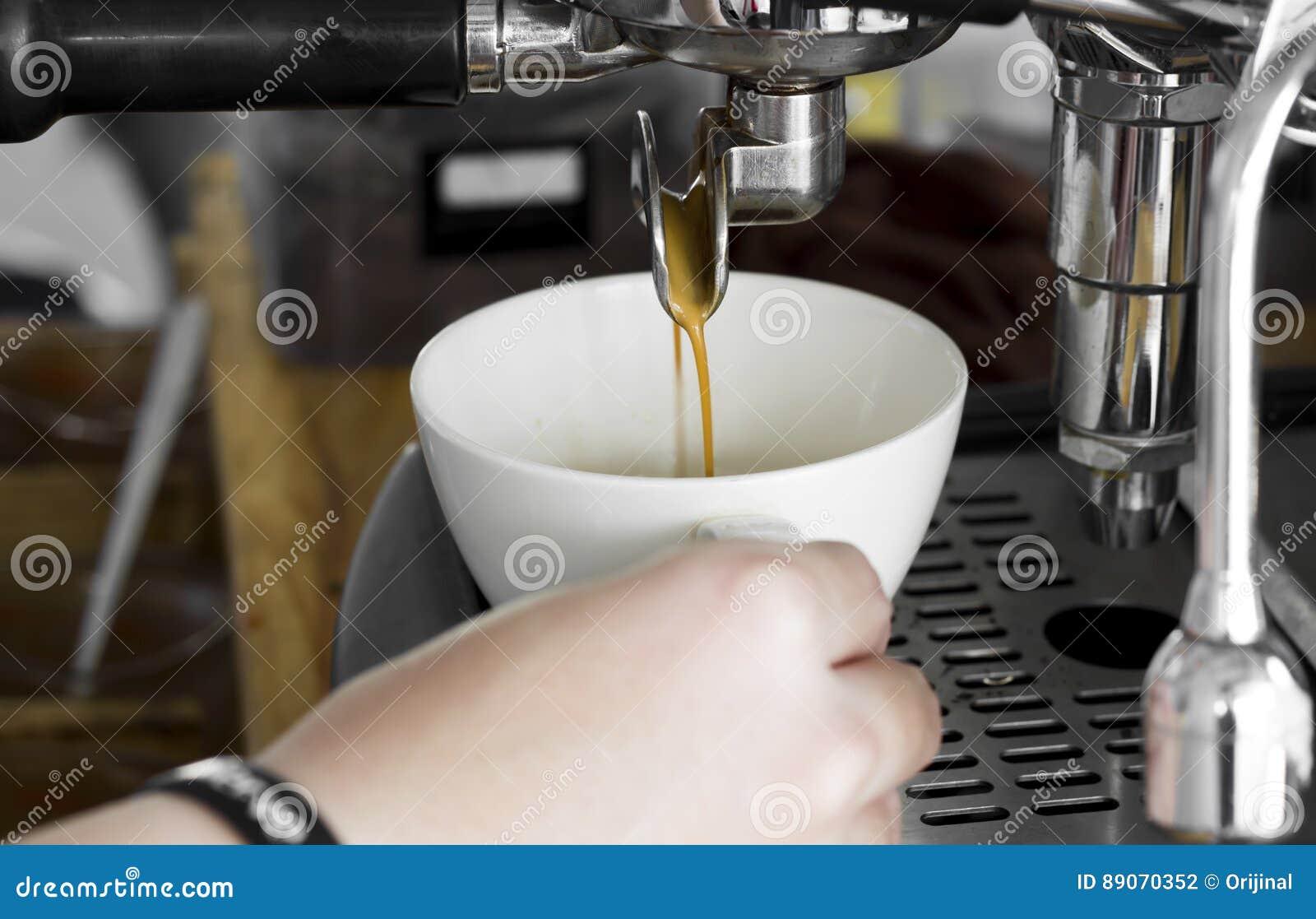 Professional coffee machine making espresso in a cafe, close-up