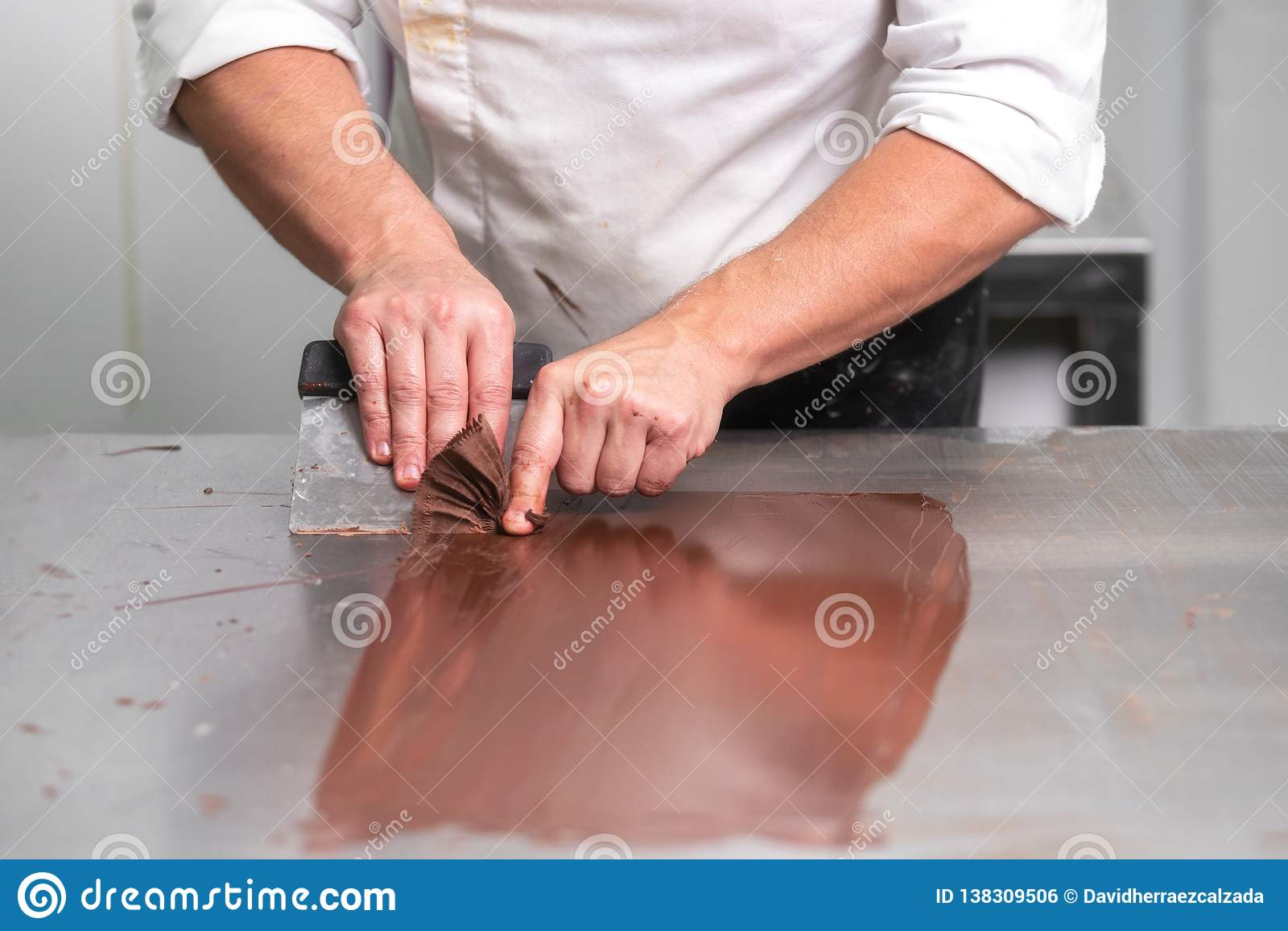 Professional Confectioner Making Chocolate Sweets At Confectionery