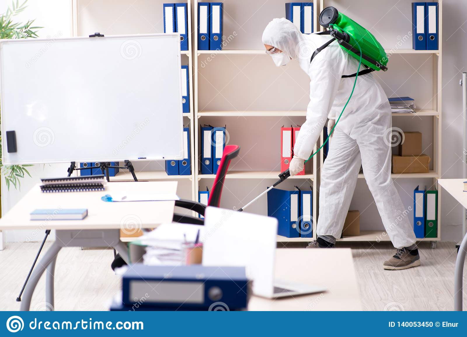 The professional contractor doing pest control at office