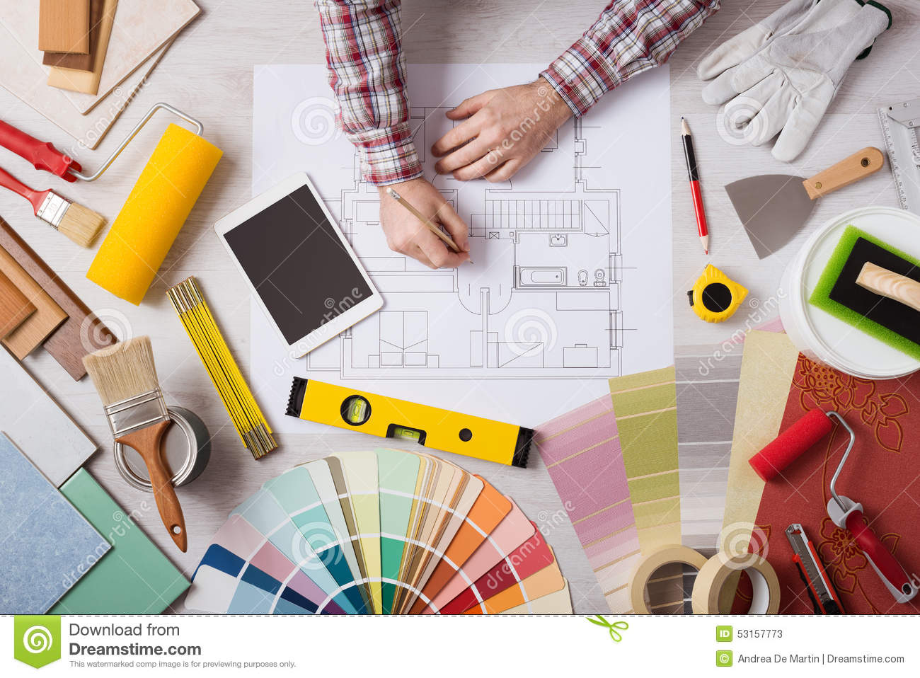 Professional decorator working at desk stock image image for Design consultancy services