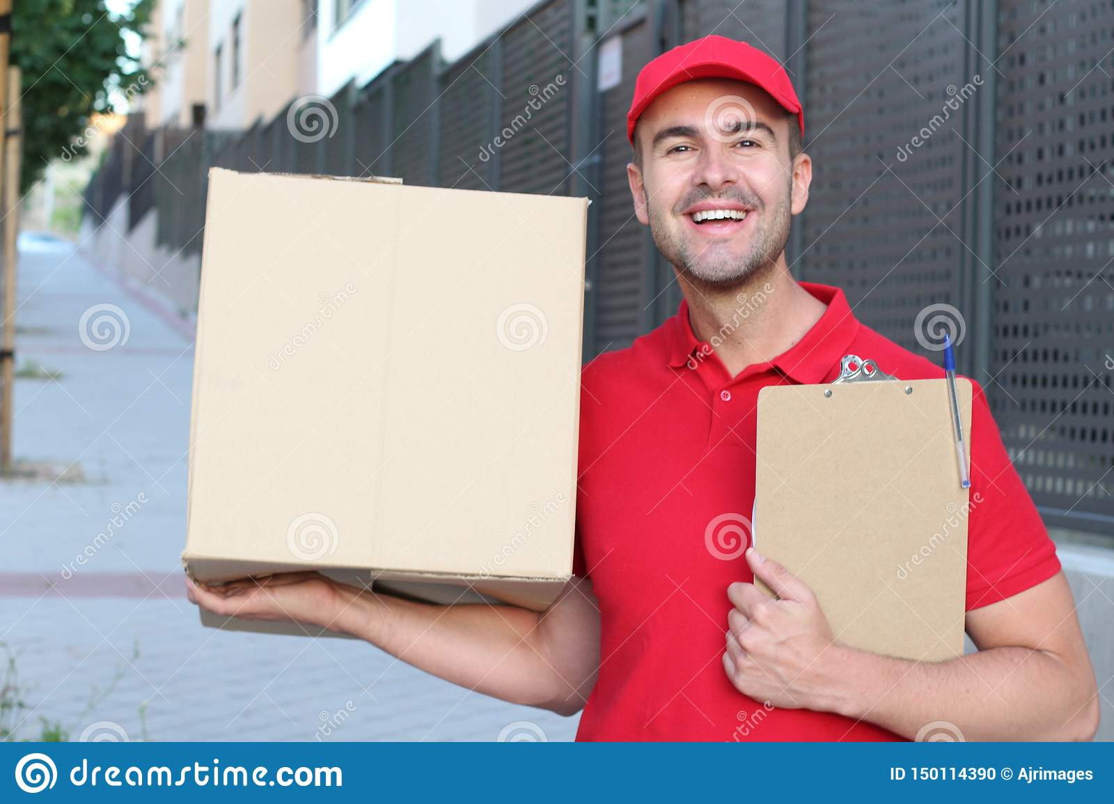Professional delivery man smiling at work