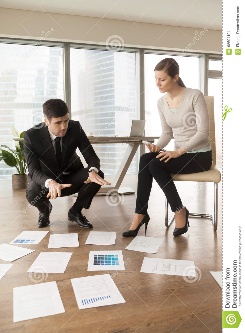 Professional Designers Working In Office Planning Project