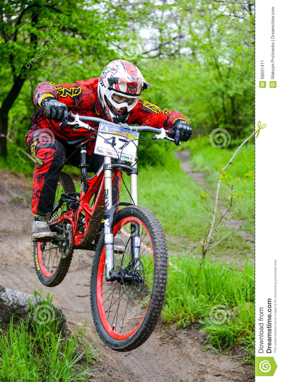 Professional DH Biker Is Riding A Mountain Bike On The ...