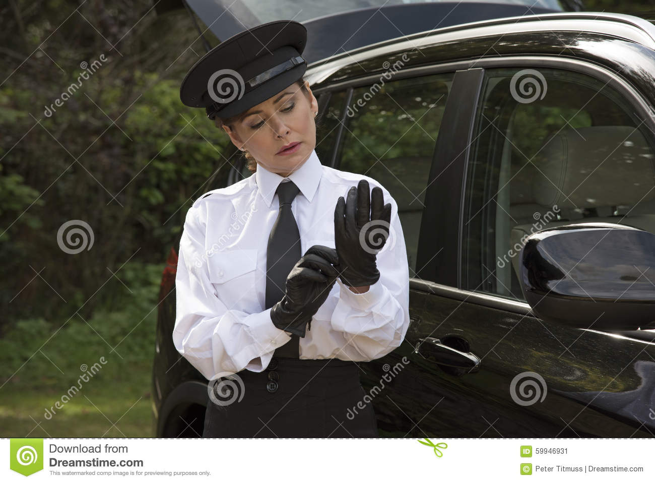 Black leather uniform gloves - Professional Driver Putting On Her Driving Gloves Stock Image