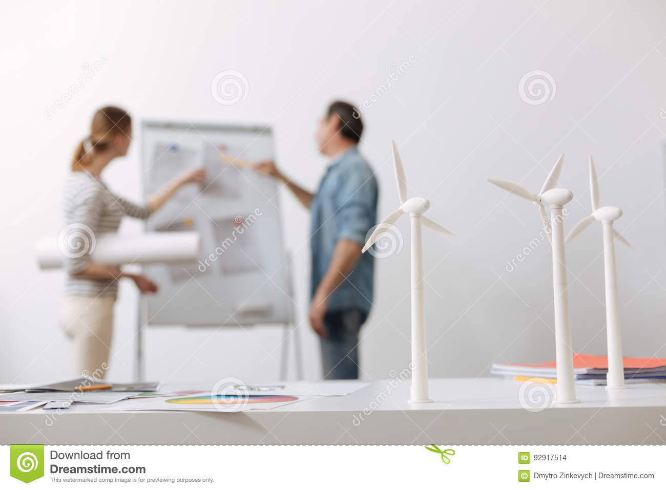 Professional Engineer Discussing Project Of Wind Turbines