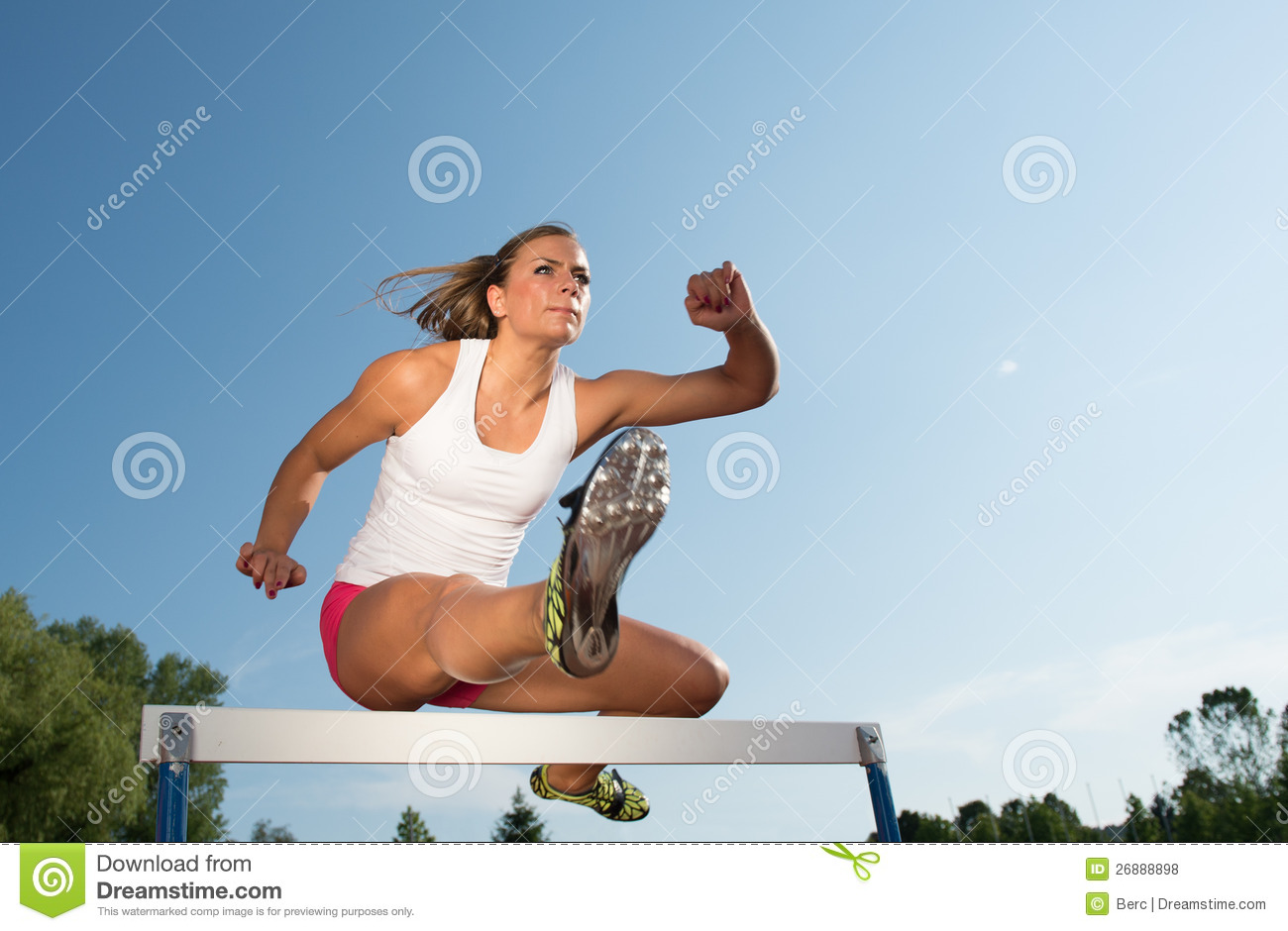 Professional Female Hurdler In Action Stock Photo Image