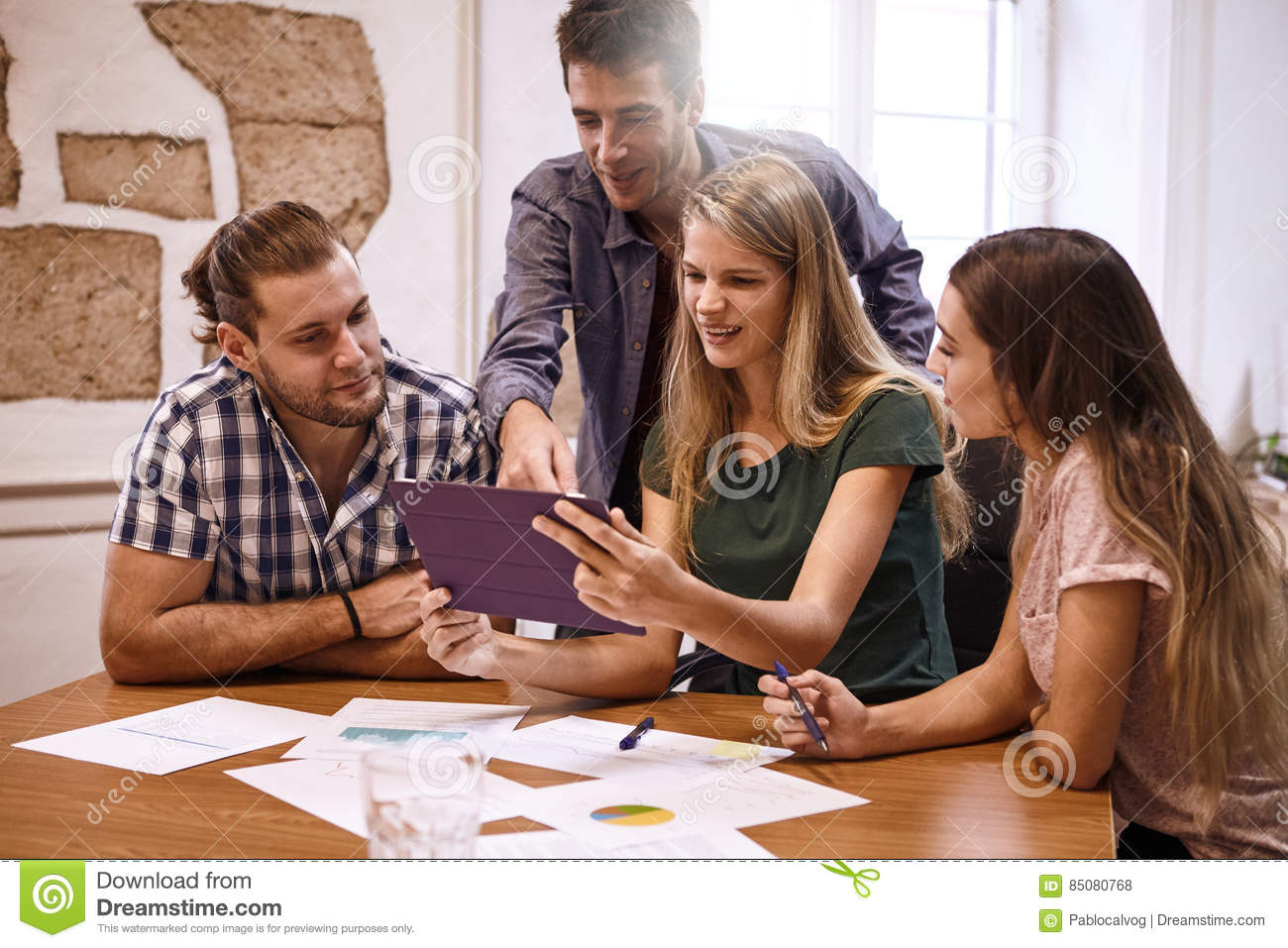 Professional group of millenials in conference