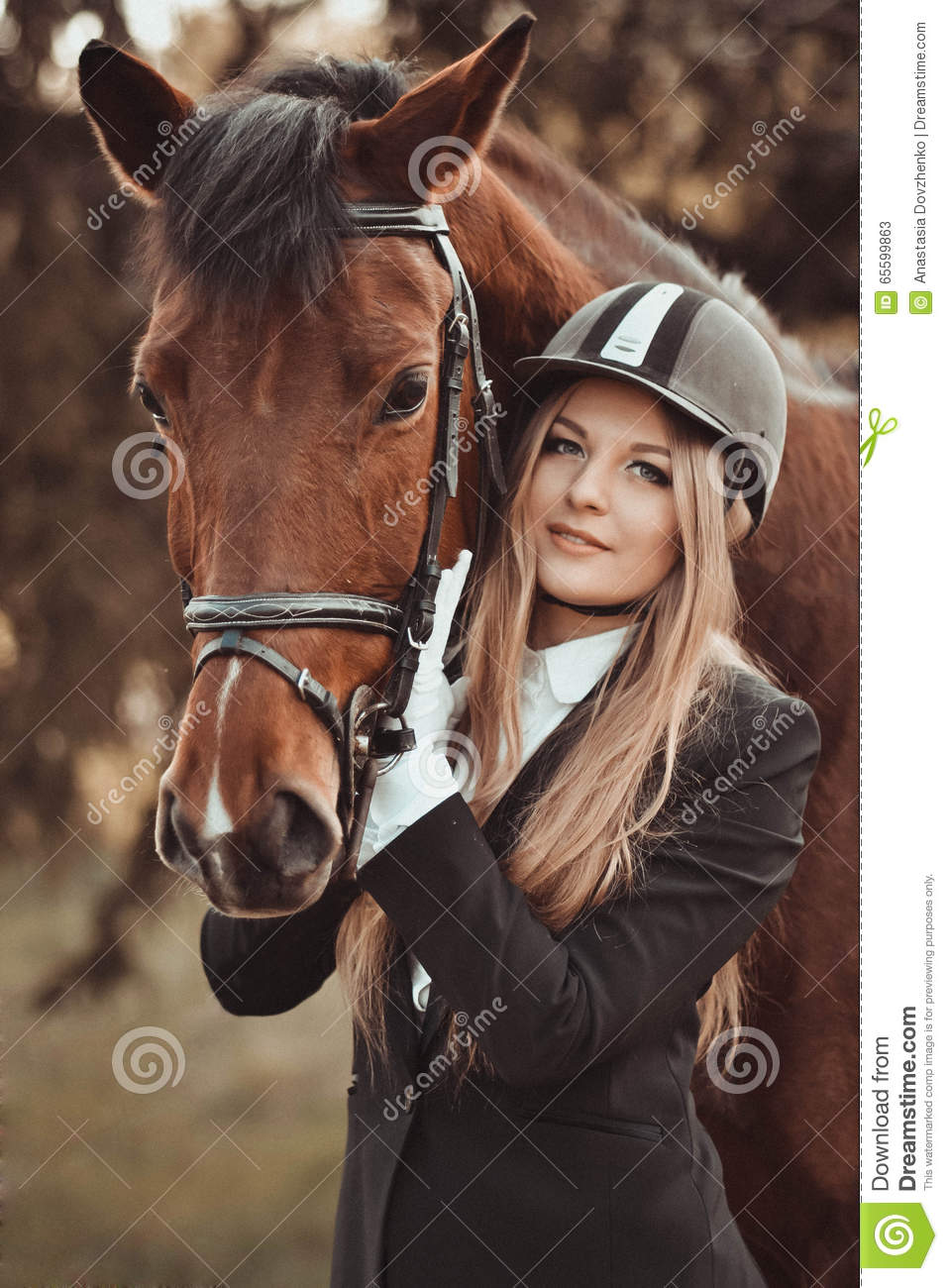Blondie,beautiful girl with a nice,brown horse in park