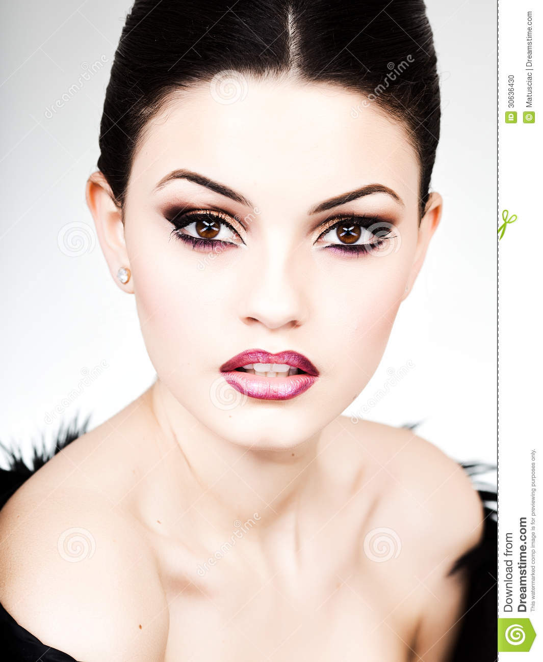 Professional make-up and hairstyle on beautiful woman face - beauty shot