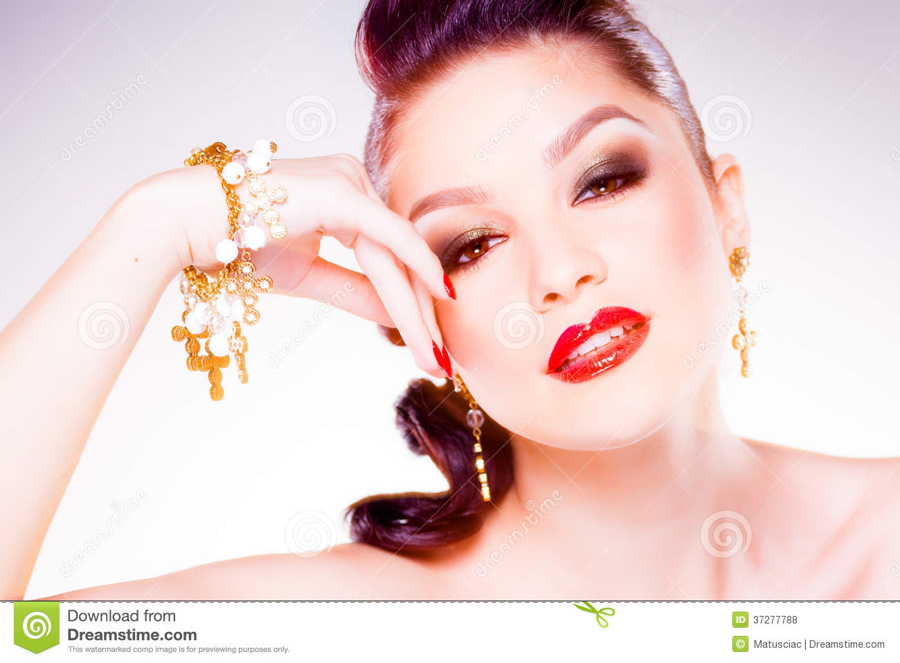 Professional make-up and hairstyle on beautiful woman face - studio beauty shot